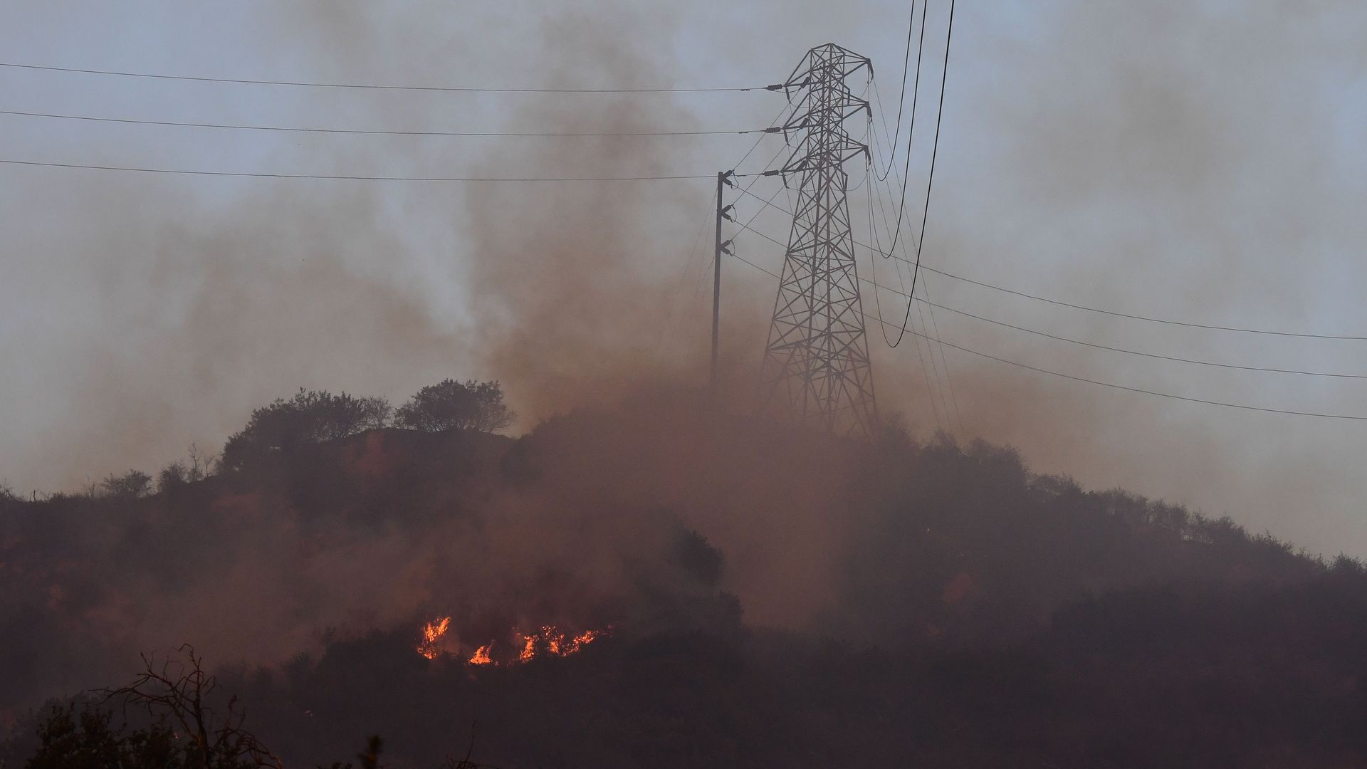 Fire burns near power lines at the Thomas Fire, December 16, 2017 in Montecito, California.