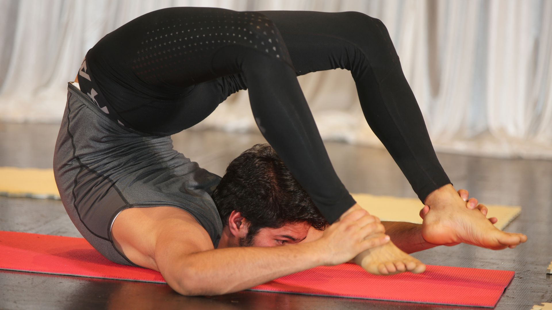 An Indian man demonstrating advanced yoga poses in Mississauga, Ontario, Canada.