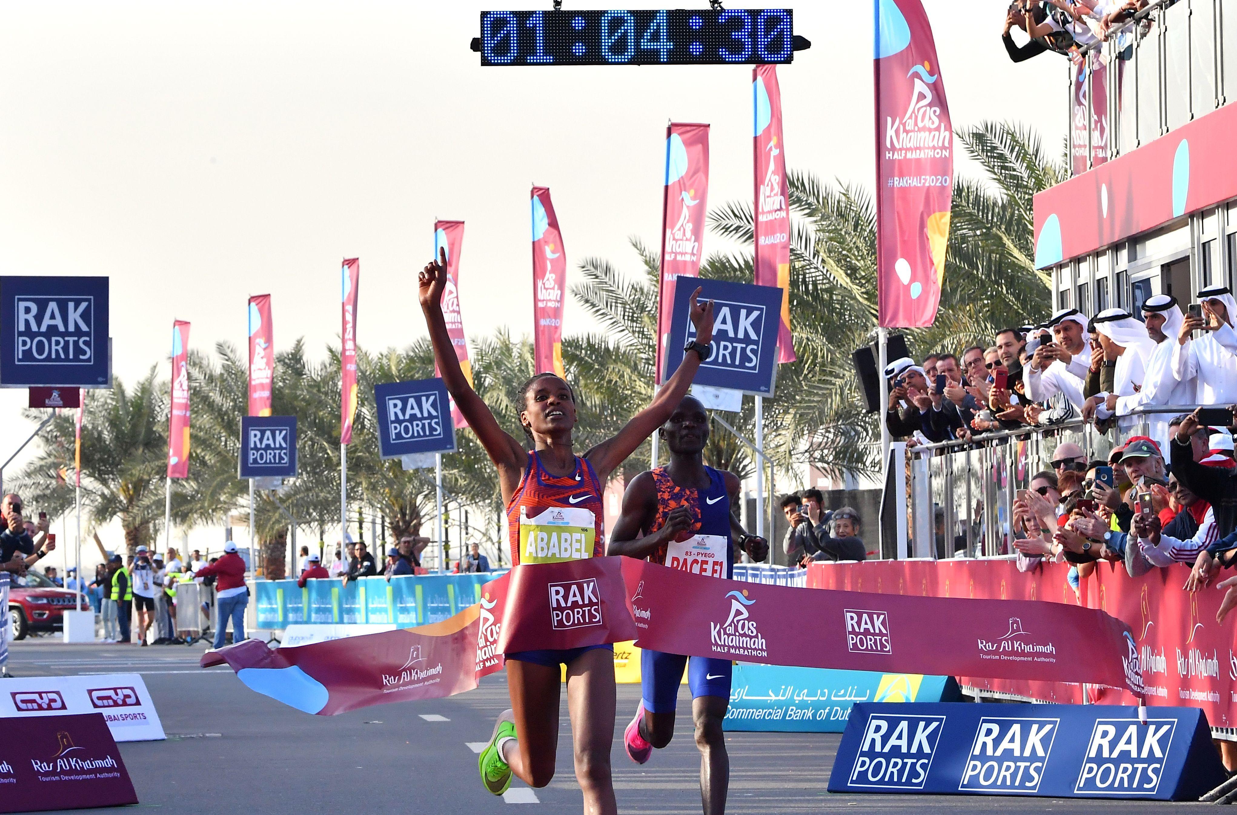 Ethiopian runner smashes half-marathon record in Nike's Vaprofly sneakers - Axios