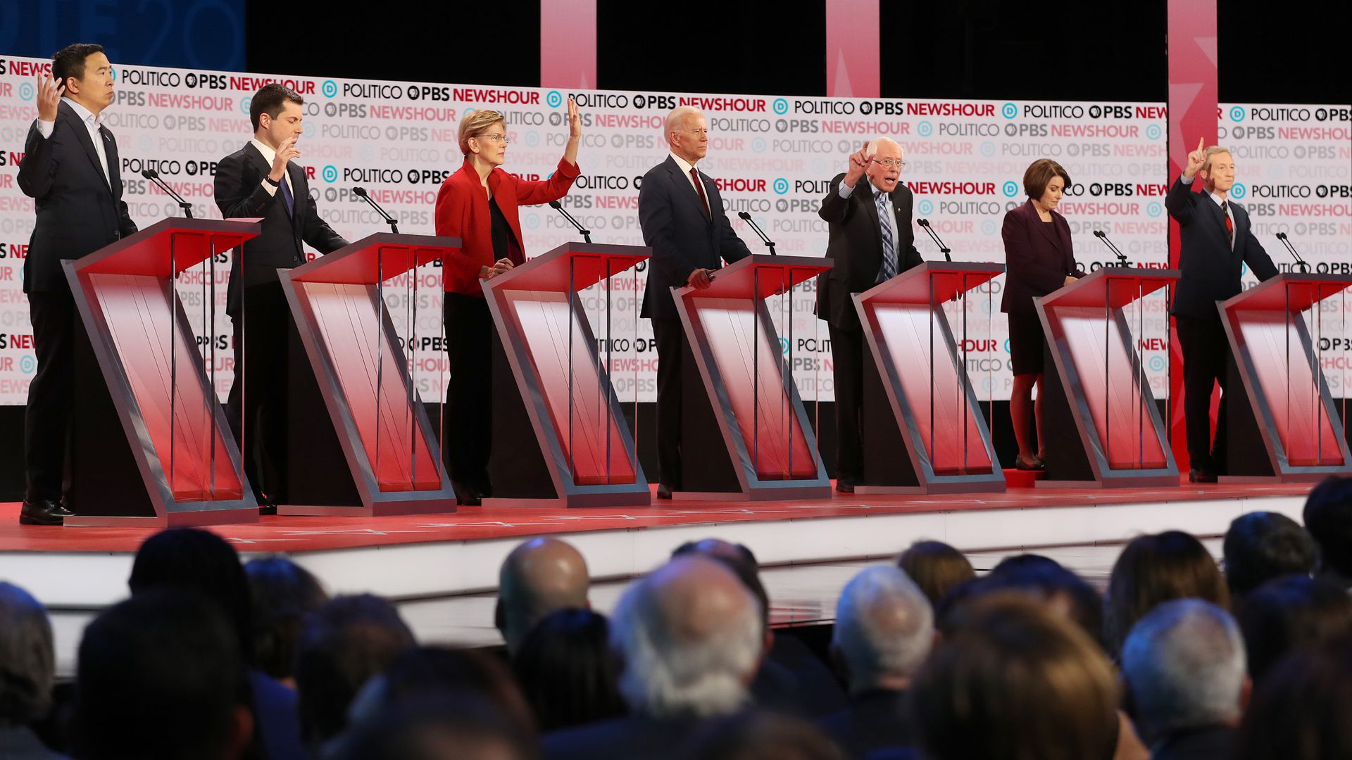 Candidates at their podiums during the debate.