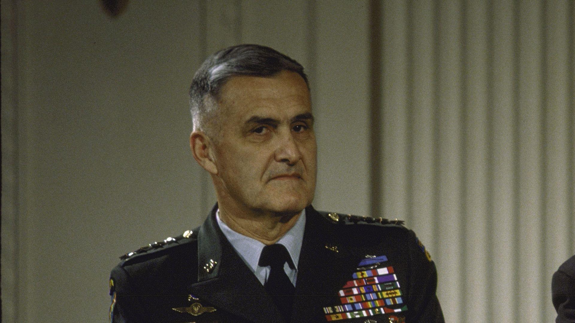Hugh Shelton sits in uniform