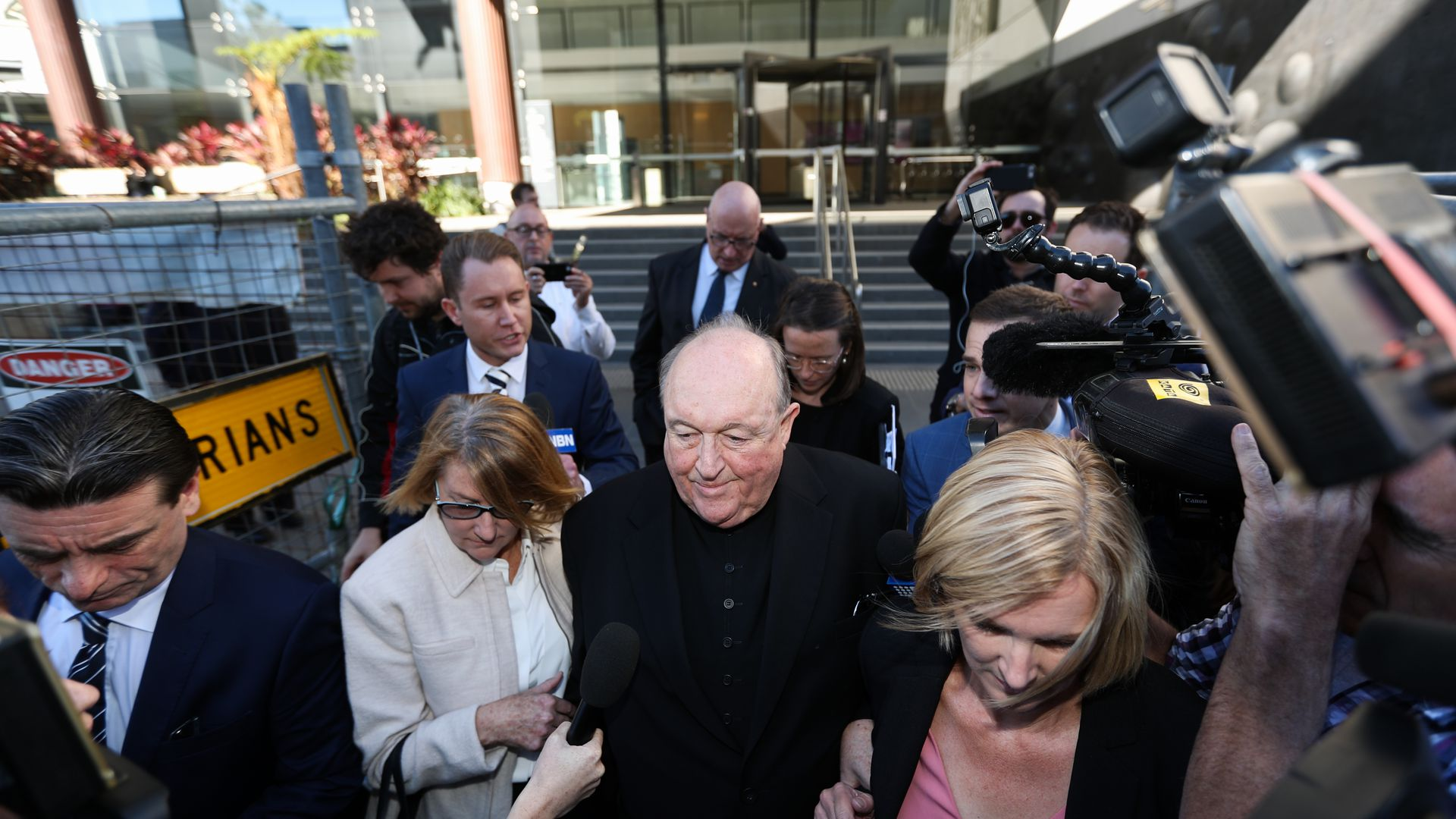 Archbishop Philip Wilson leaving courthouse