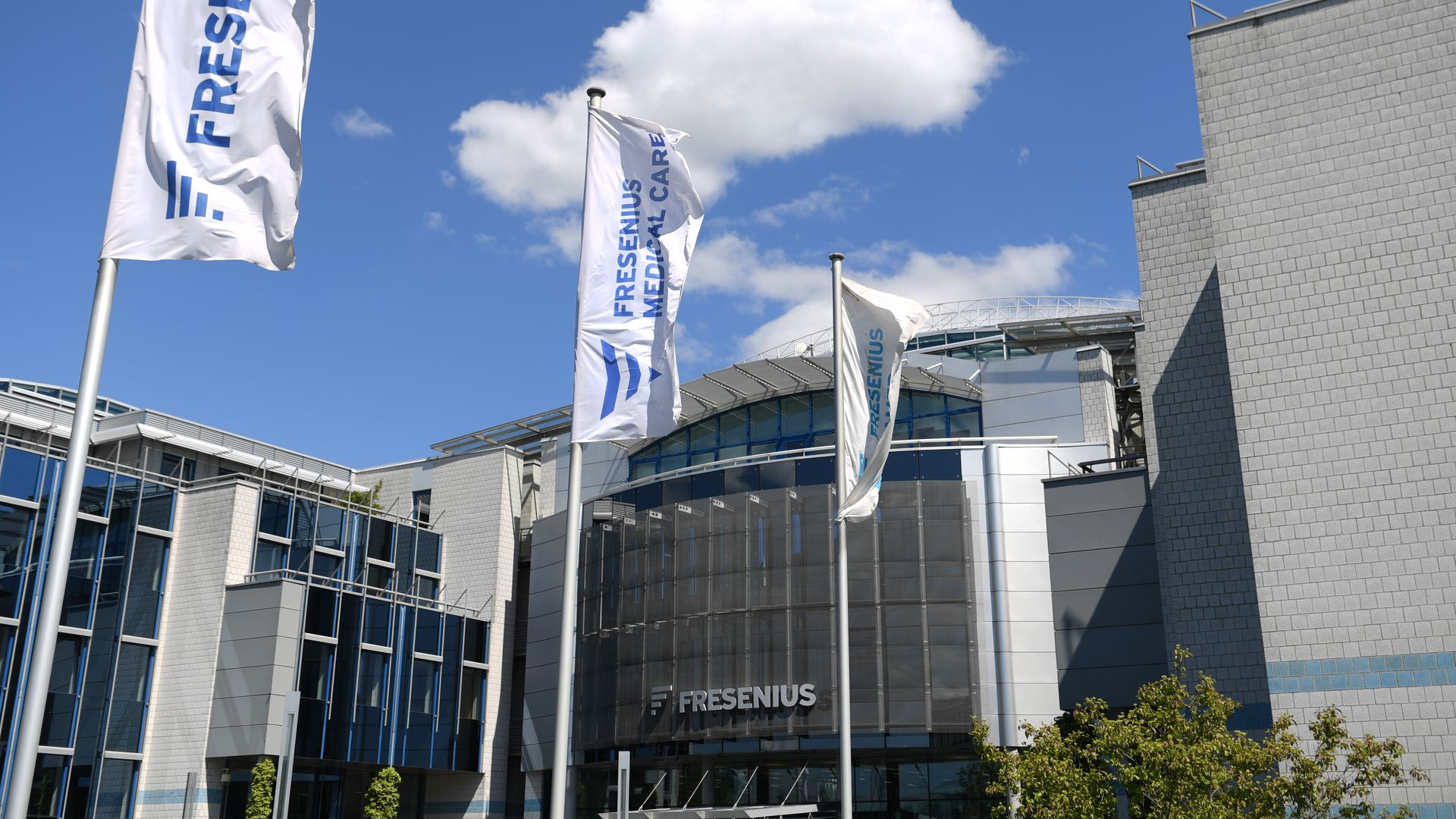 Fresenius flags fly in front of the Fresenius headquarters building.