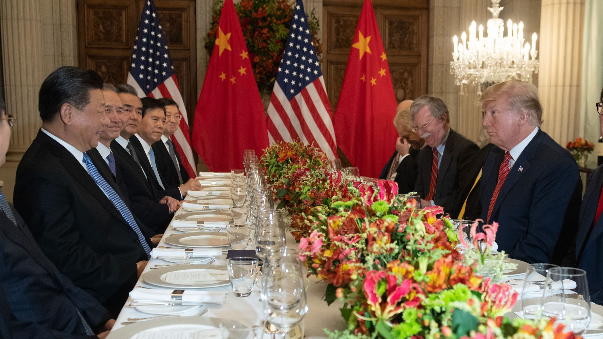 US President Donald Trump (R) and China's President Xi Jinping (L) along with members of their delegations, hold a dinner meeting at the end of the G20 summit.