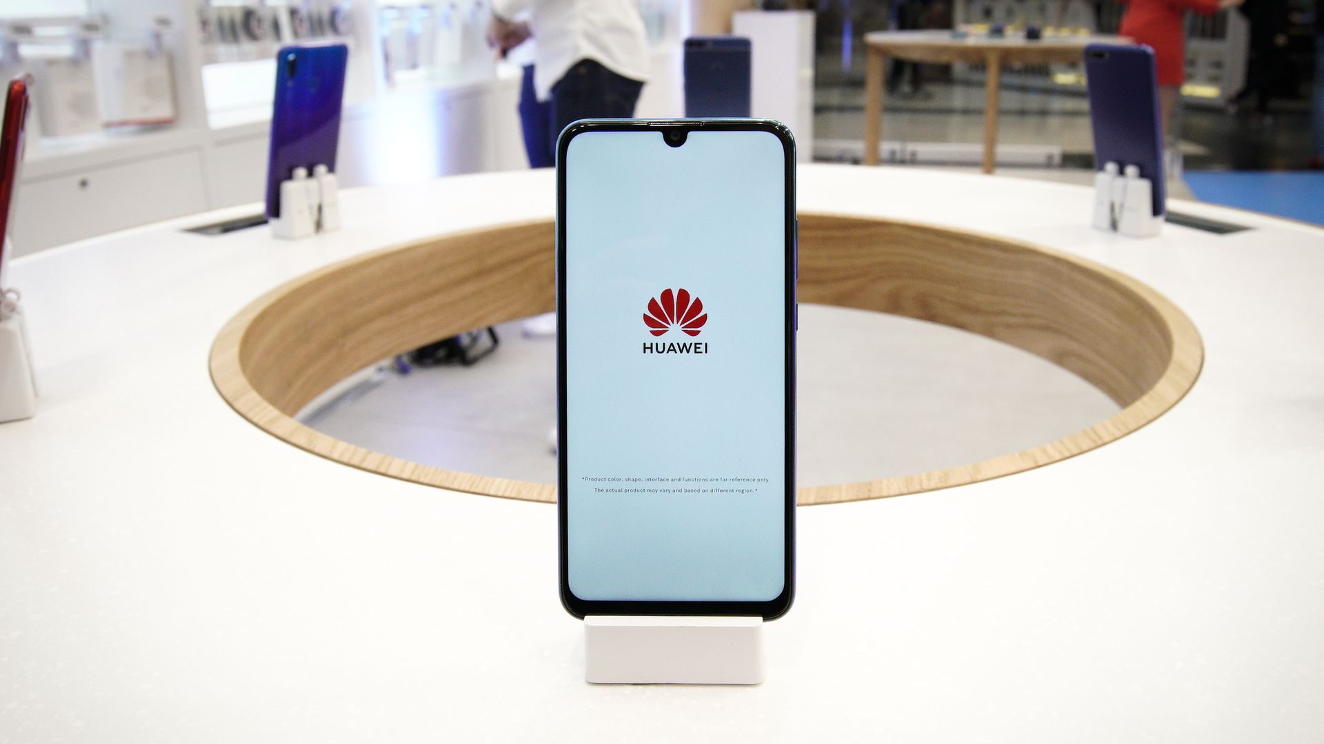 A Huawei mobile phone is seen on display at the flagship store in Warsaw, Poland