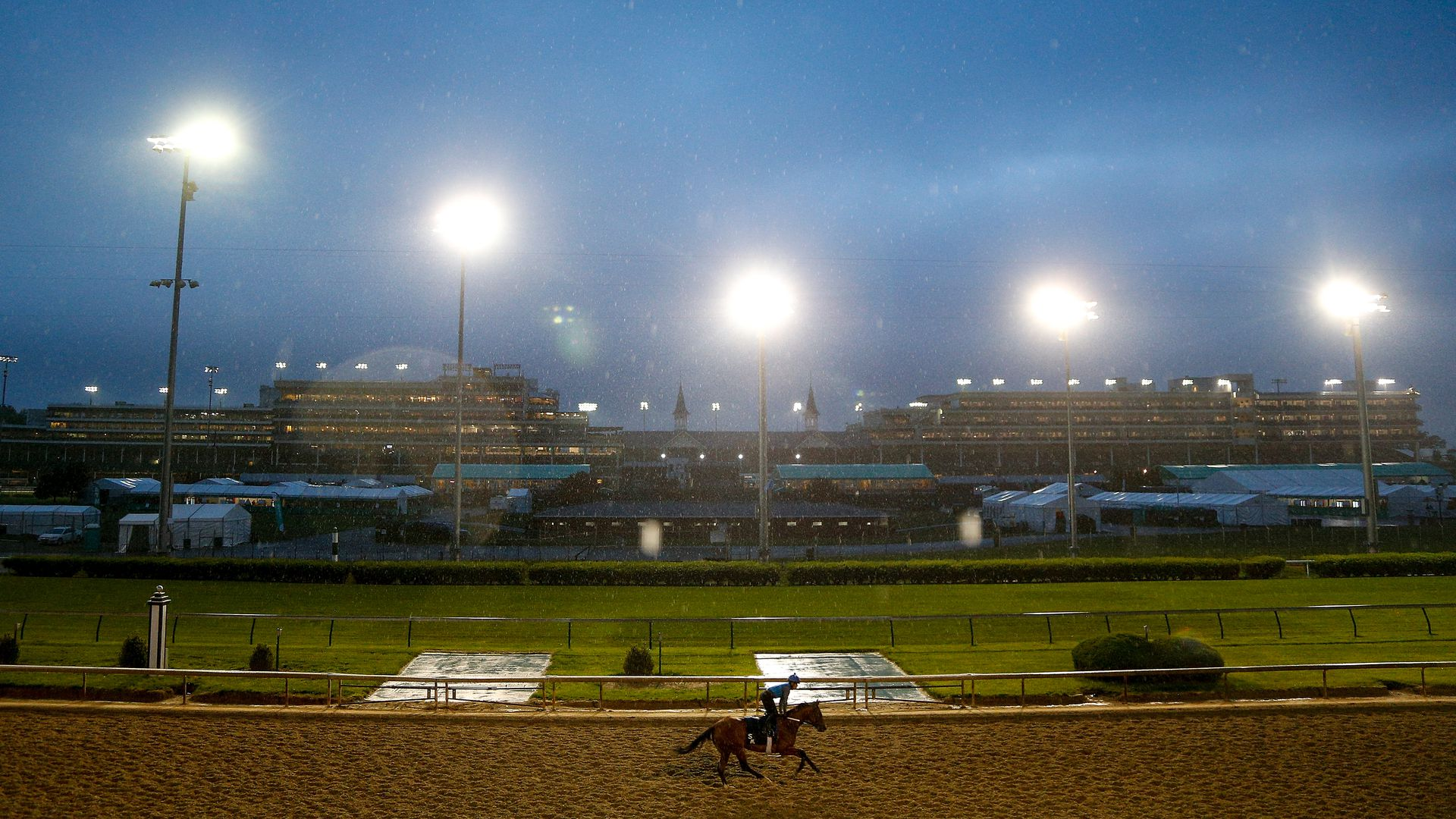 A horse trains on the track during morning workouts in preparation for the 144th Kentucky Derby .