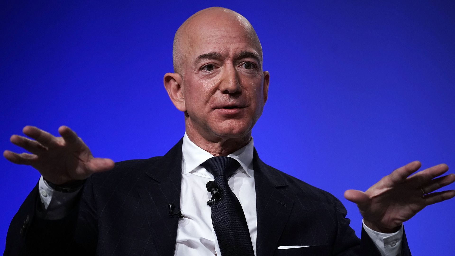 Amazon CEO Jeff Bezos gestures as he speaks