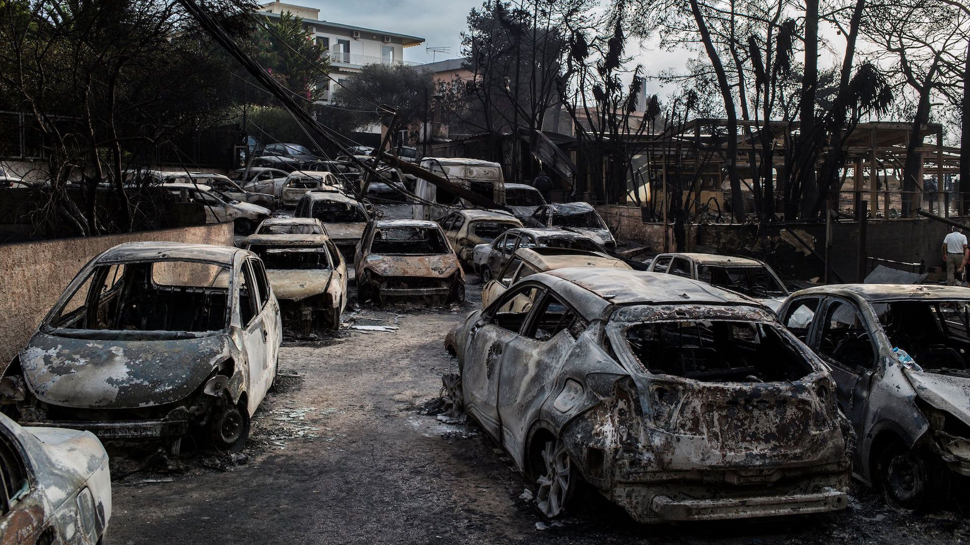 This photo taken on July 24, 2018 show cars burnt following a wildfire at the village of Mati, near Athens.