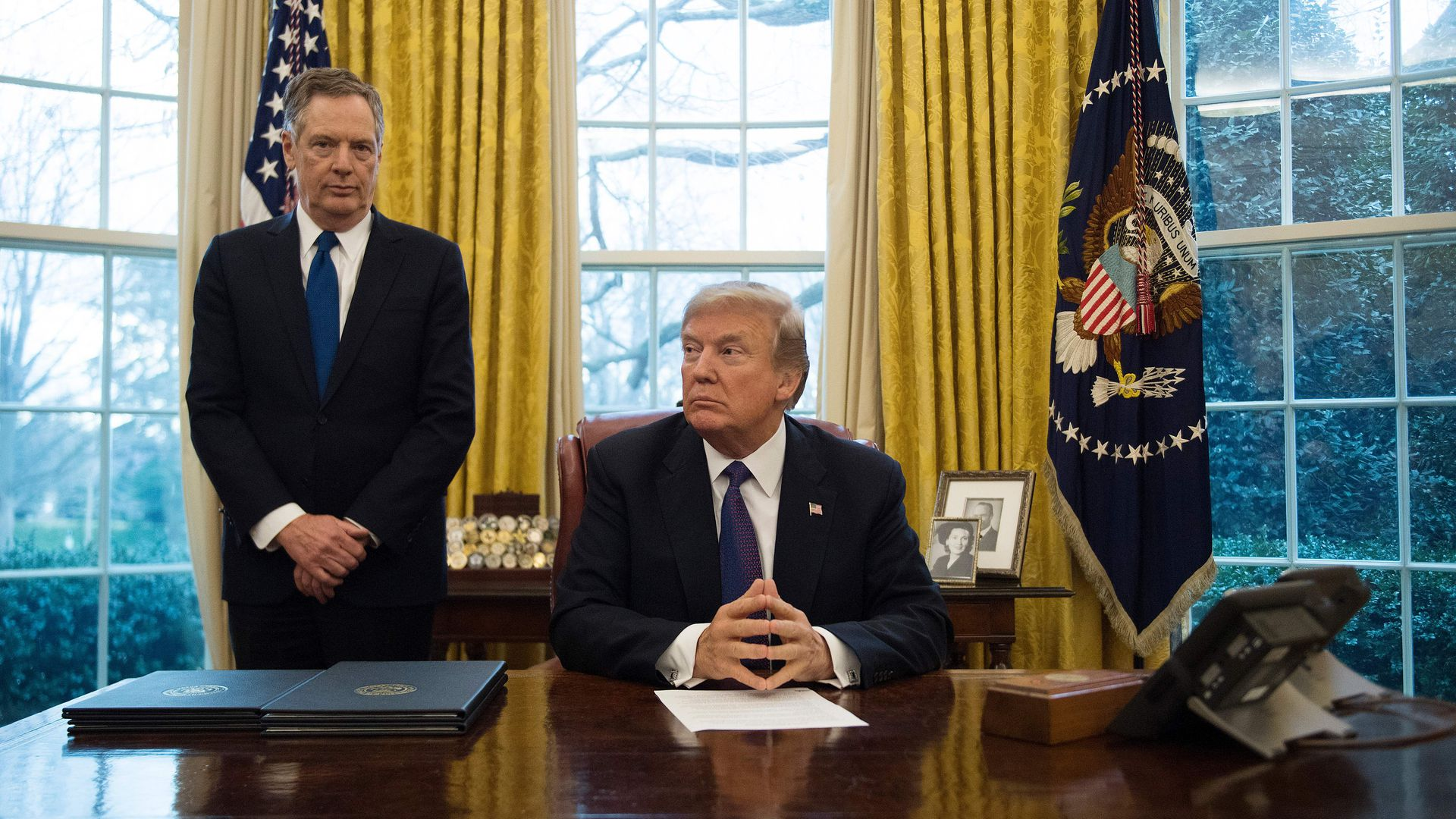 President Donald Trump sits with United States Trade Representative Robert Lighthizer in the Oval Office of the White House in Washington, DC, on January 23, 2018.