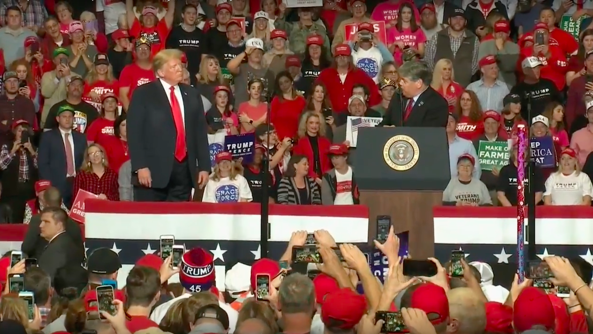 Sean Hannity joins Trump on stage at rally after tweeting he wouldn't