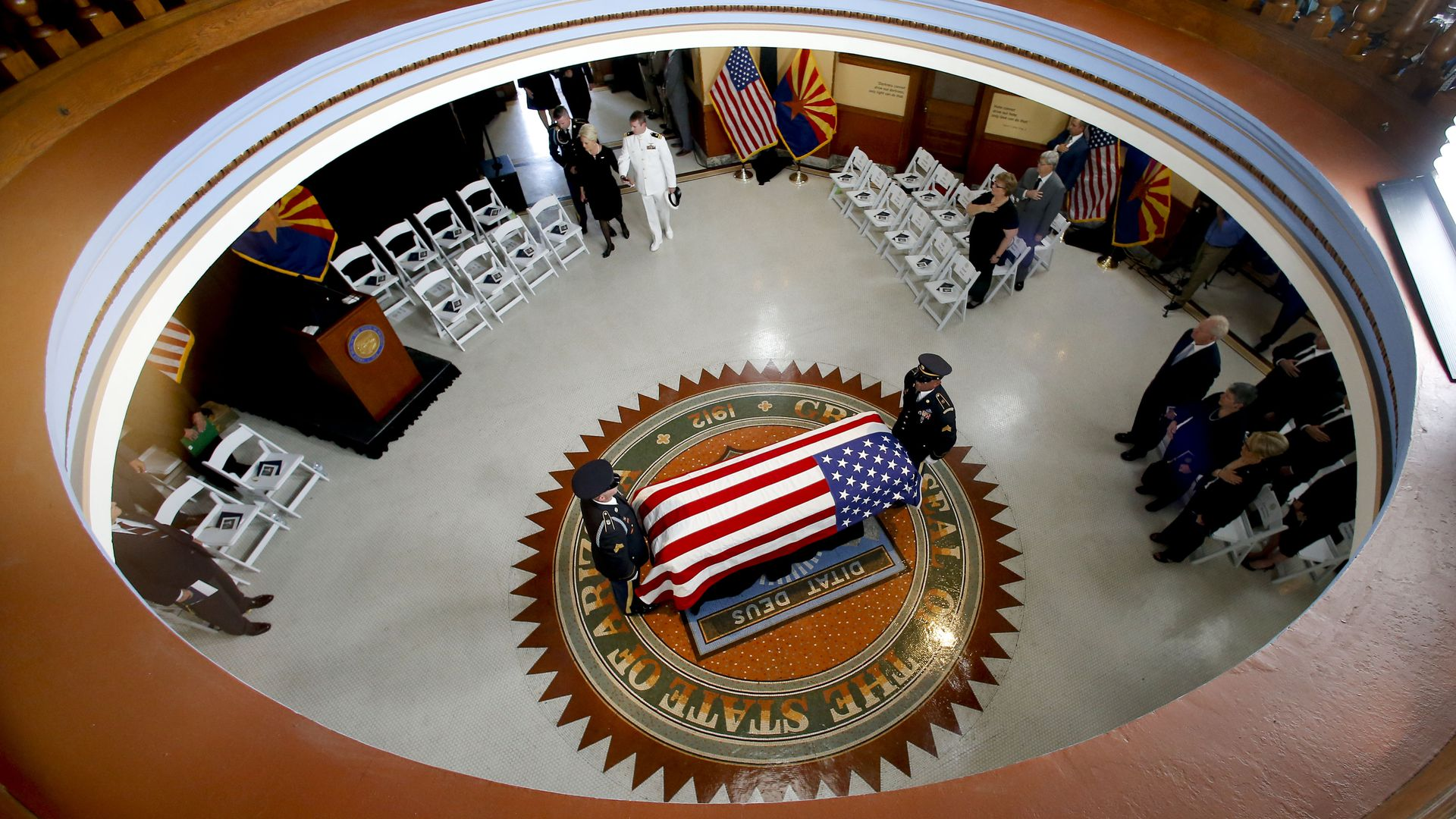 McCain's casket covered in an American flag, seen from above