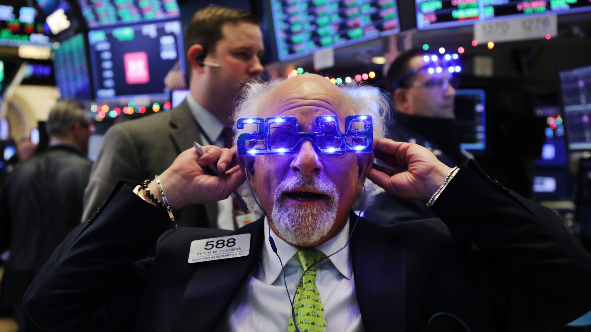 Stock traders work on the last day of 2018