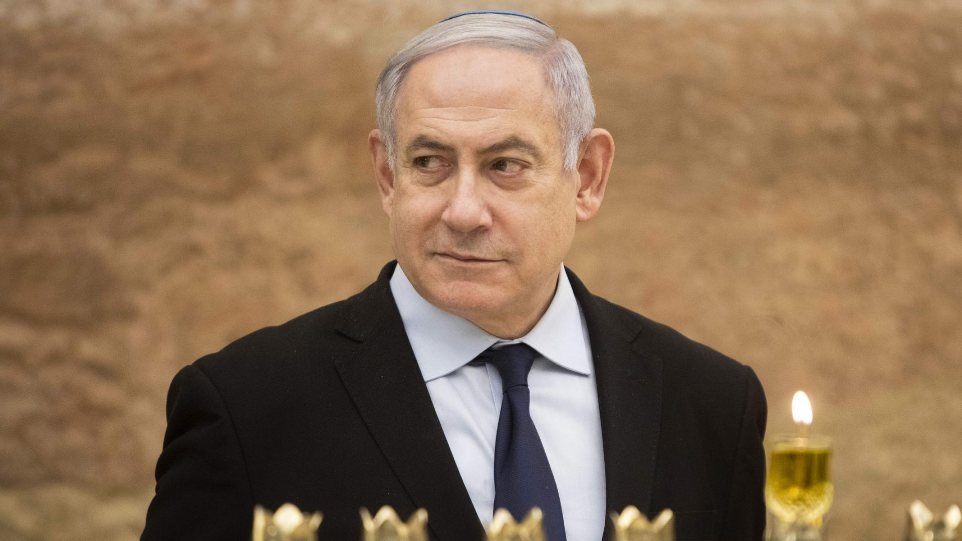 Israeli Prime Minister Benjamin Netanyahu looks on after lighting a Hanukkah candle at the Western Wall, Judaism's holiest prayer site, in the Old City of Jerusalem on December 22