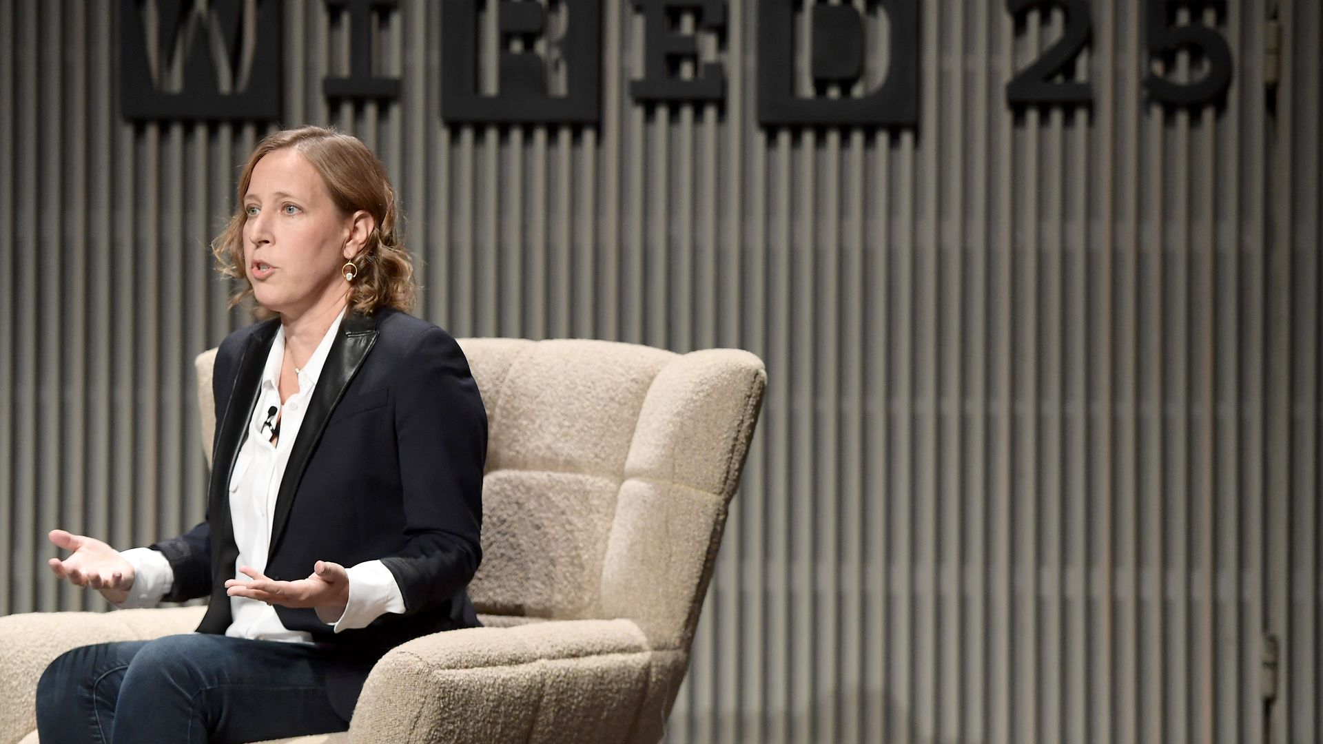 Susan Wojcicki sits onstage behind a sigh that says WIRED25