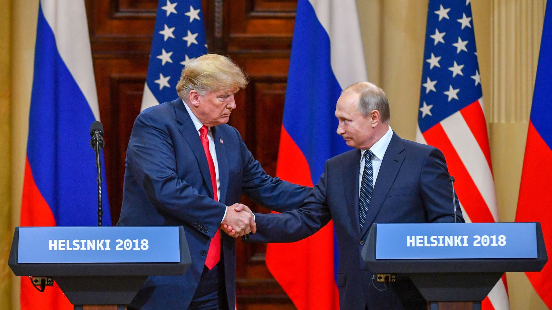 Trump and Putin shake hands