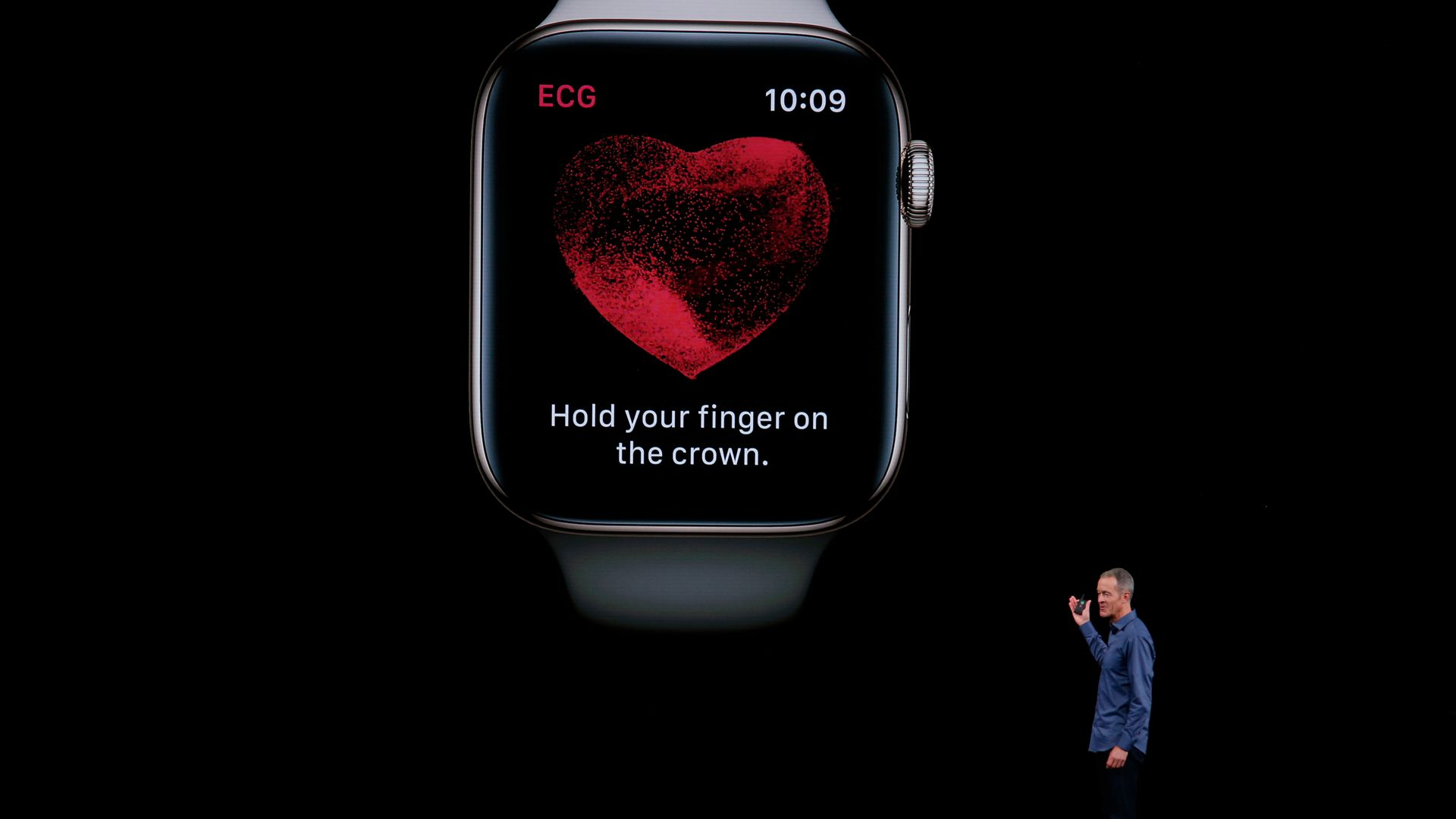 An Apple executive presents the EKG reader on the new Apple Watch