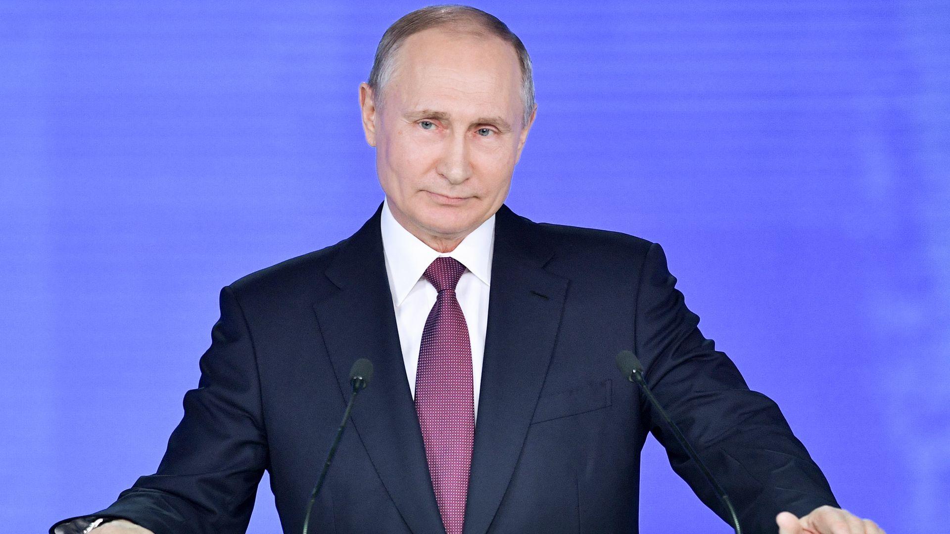 Vladimir Putin at lectern