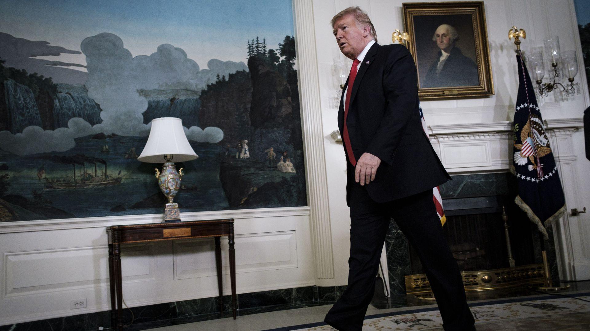 President Trump walking in Oval office