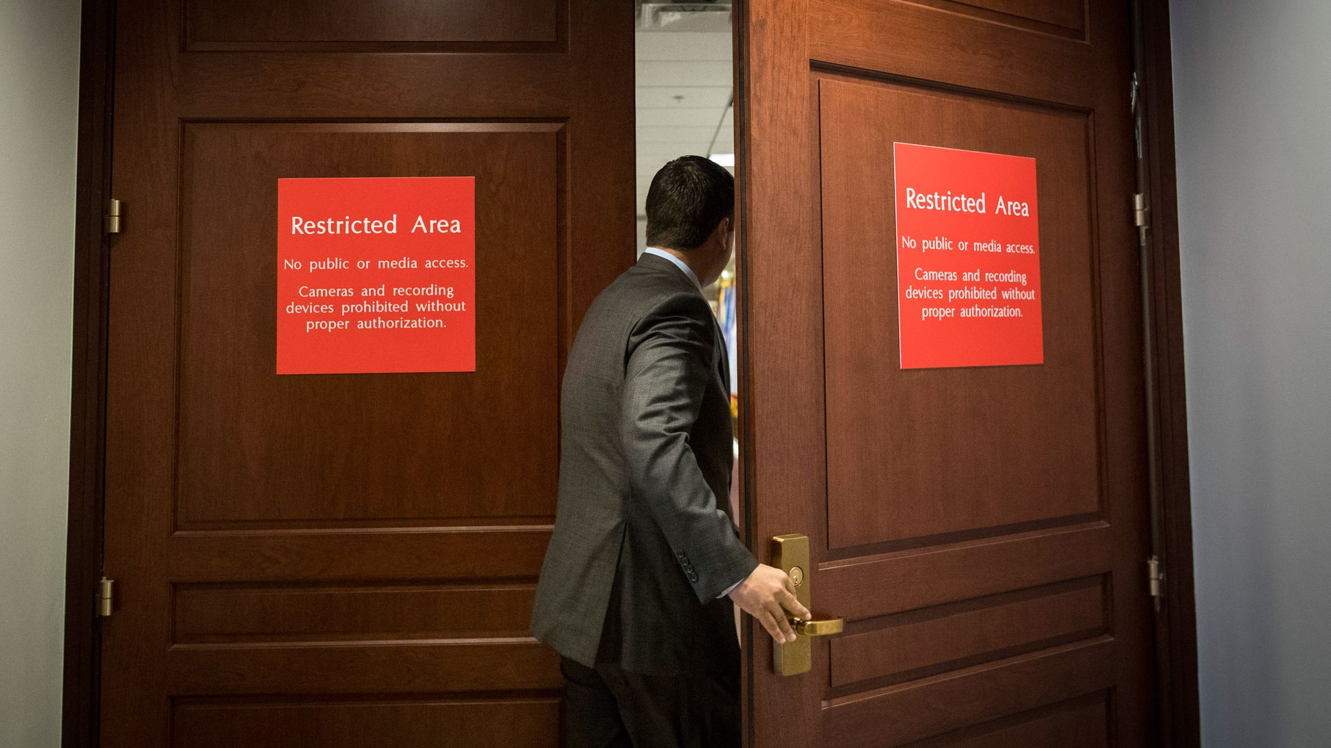 Devin Nunes entering a room