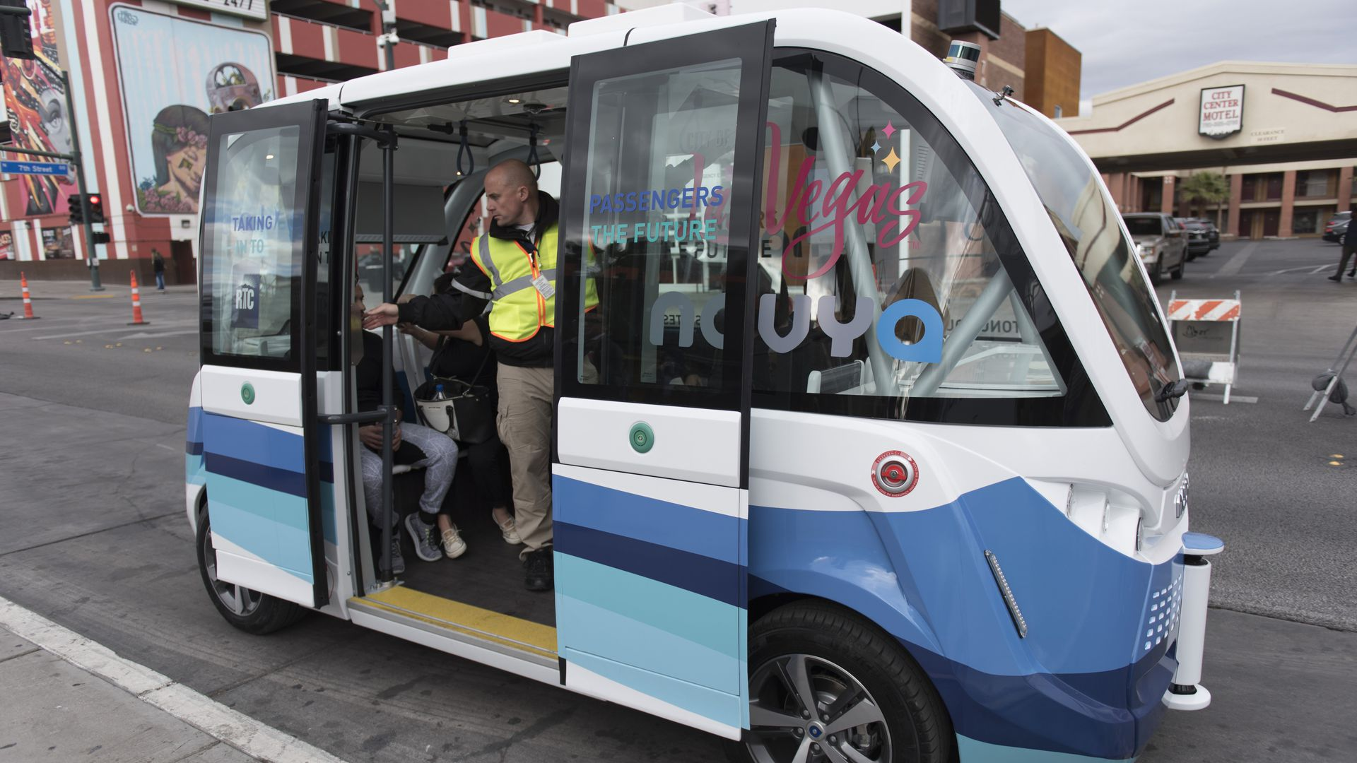 self-driving shuttle on Fremont Street in Las Vegas with passengers on board