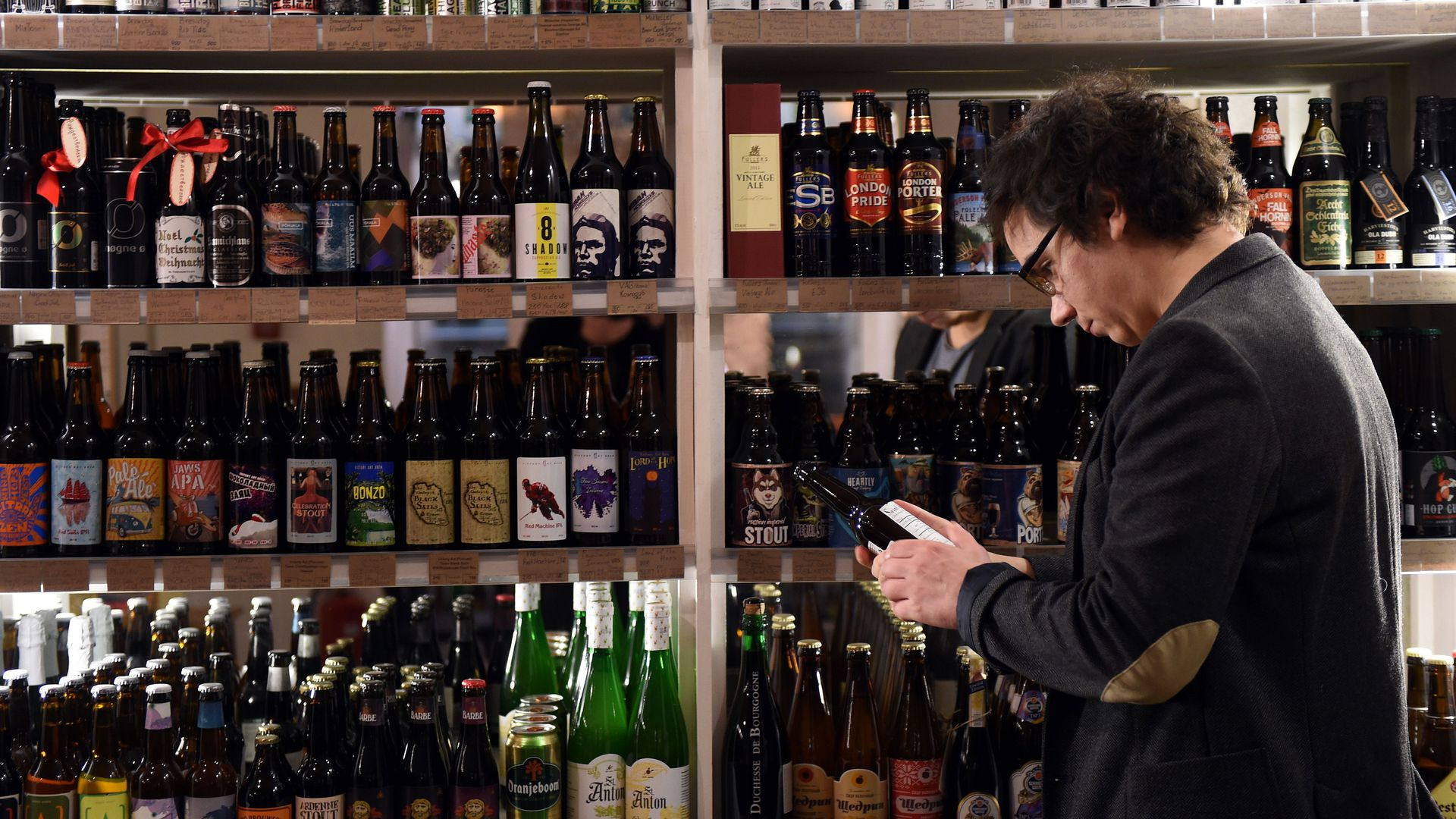 A man in Moscow looks at craft beer.