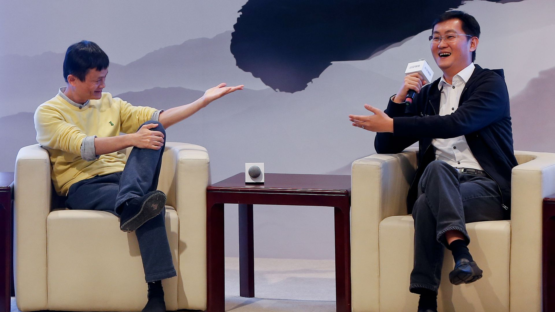 Jack Ma and Pony Ma speaking at a conference