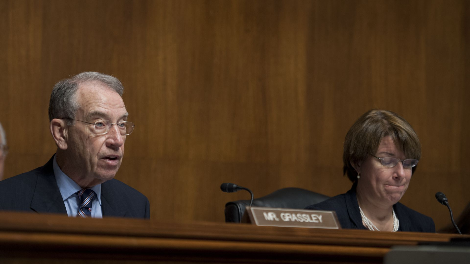 Chuck Grassley and Amy Klobuchar at a Senate committee hearing.