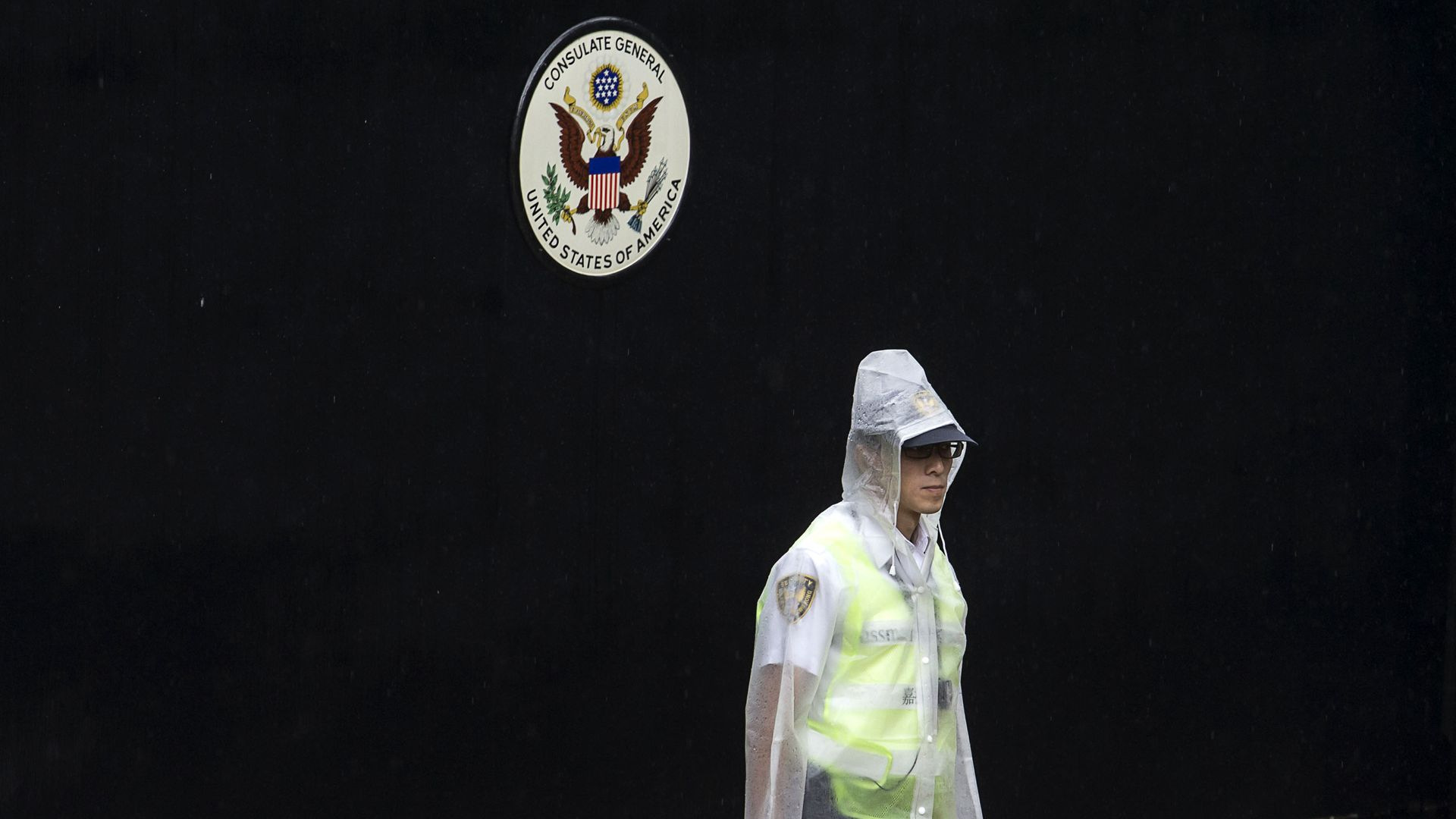 A police officer at the entry of a U.S. consulate in China.
