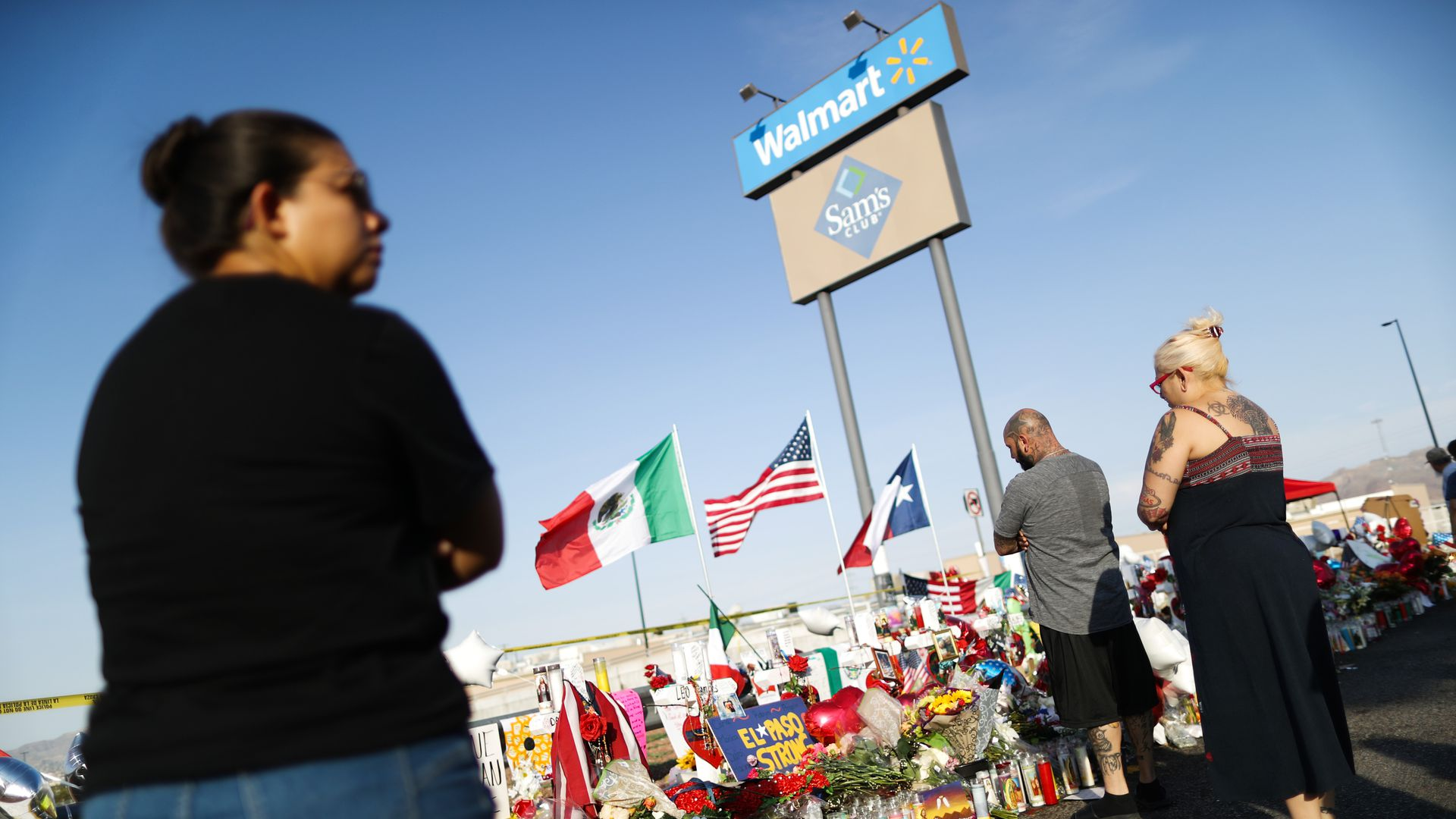 People gather in front of a Walmart in El Paso to remember the victims of a mass shooting