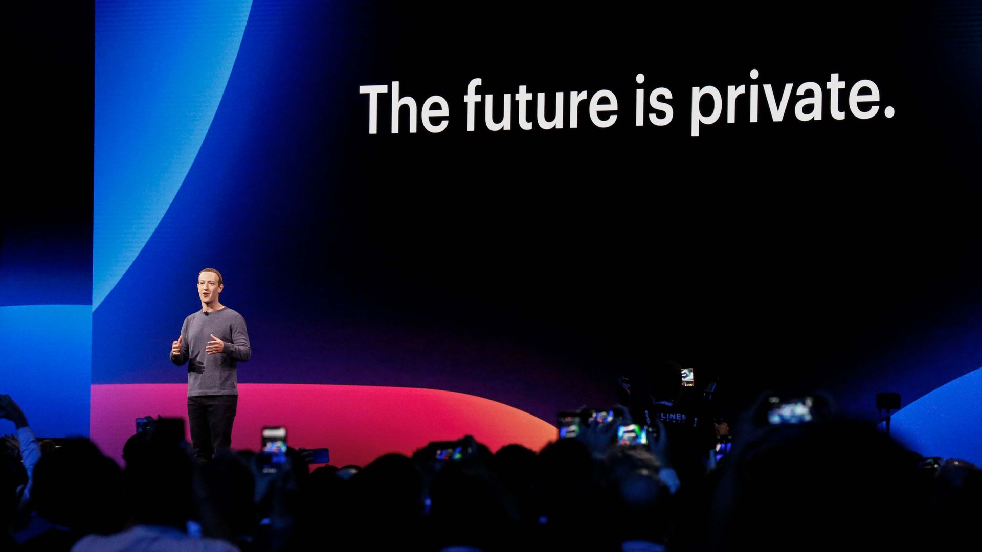 "Photo of Mark Zuckerberg standing before crowd with slide reading ""The future is private"""