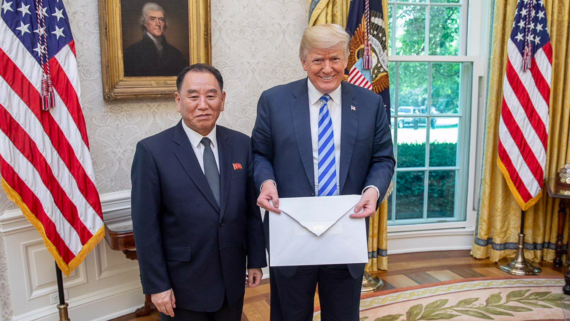 Trump holds a letter from Kim