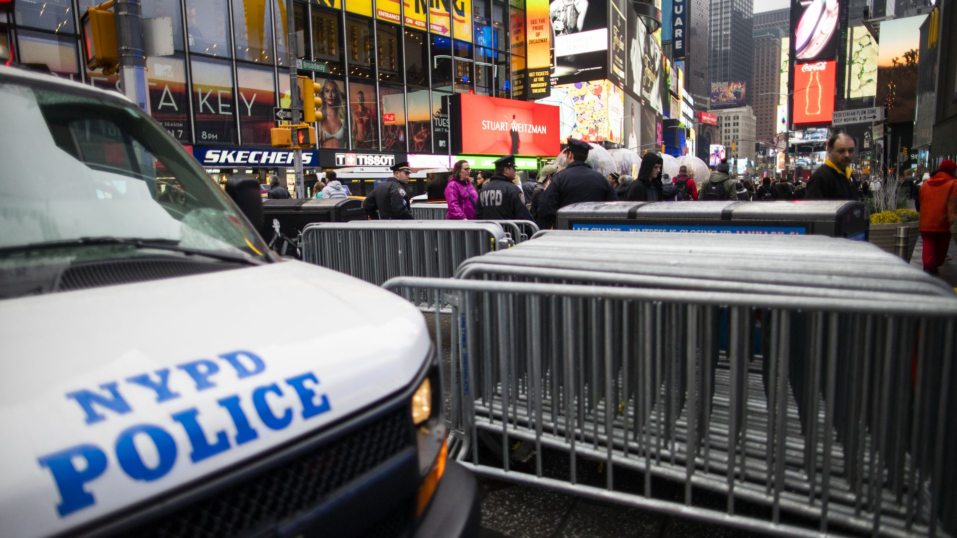"""In this image, a NYPD vehicle says """"NYPD police"""" on it"""