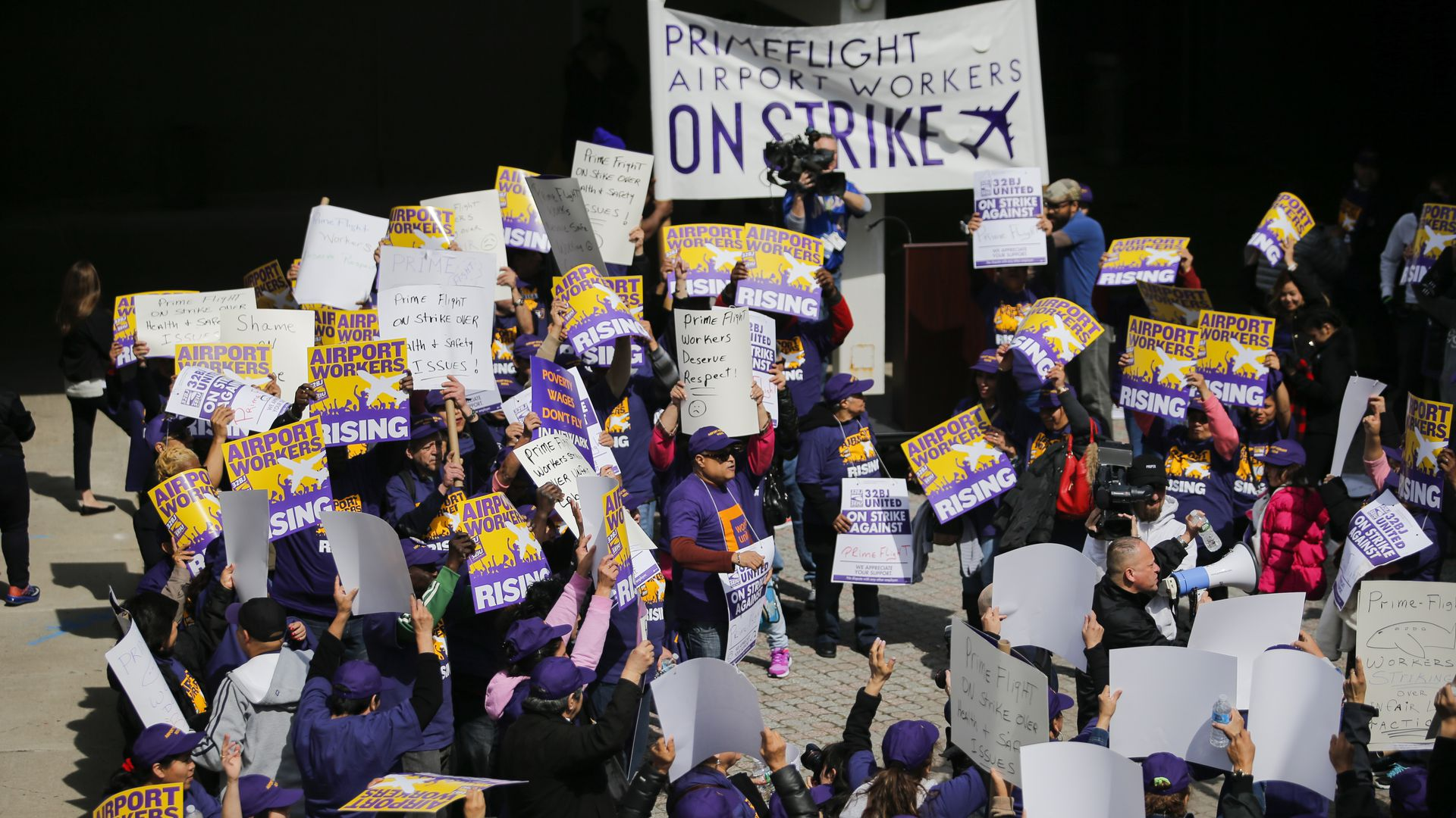 Airport workers take part in a strike at the Newark International Airport in March 2016. Photo by VIEW press/Corbis via Getty Images