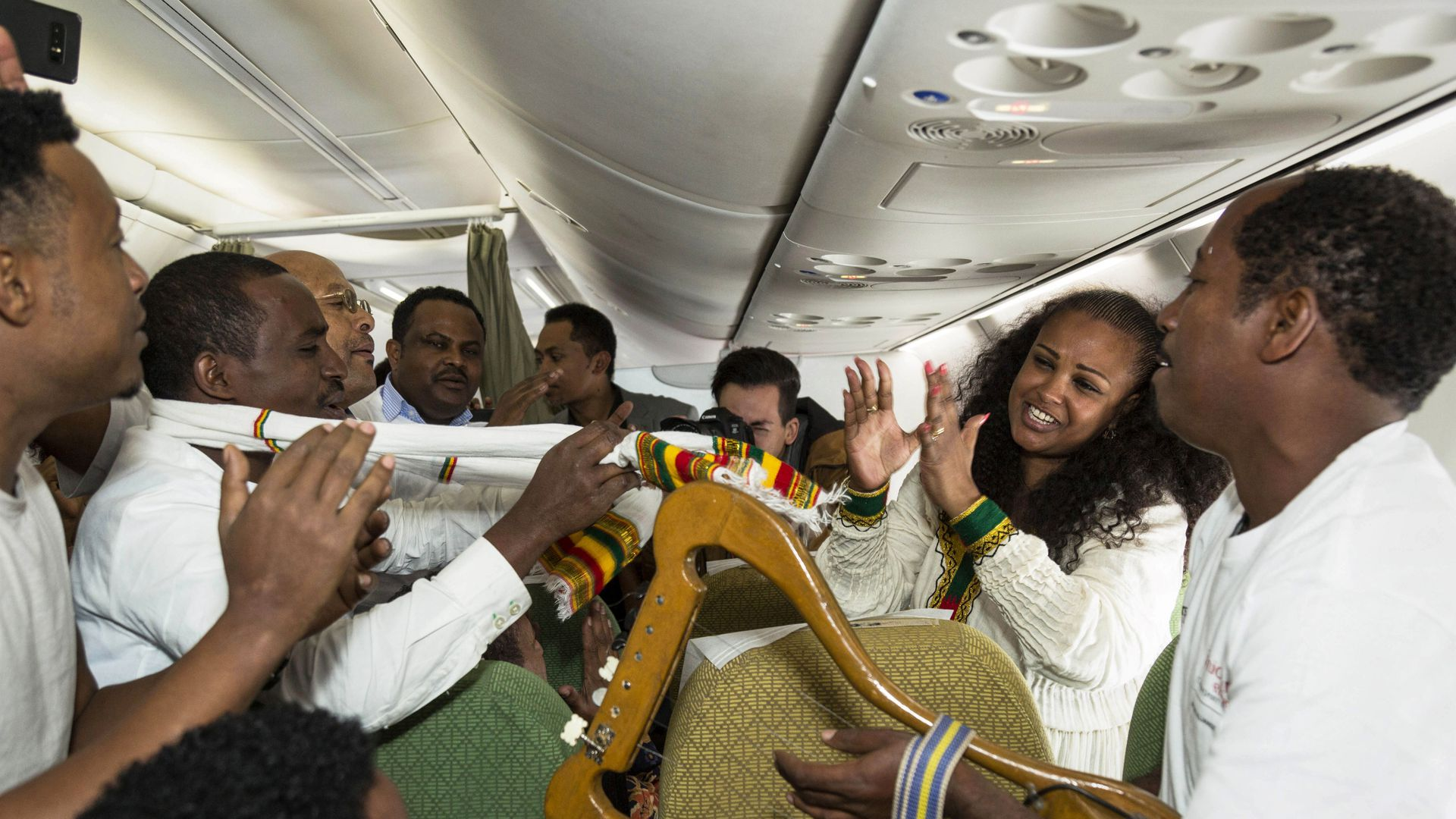 Passengers sing and dance during the first flight between the Ethiopian capital Addis Ababa and the Eritrean capital Asmara in twenty years. Photo: Michael Tewelde/AFP/Getty Images