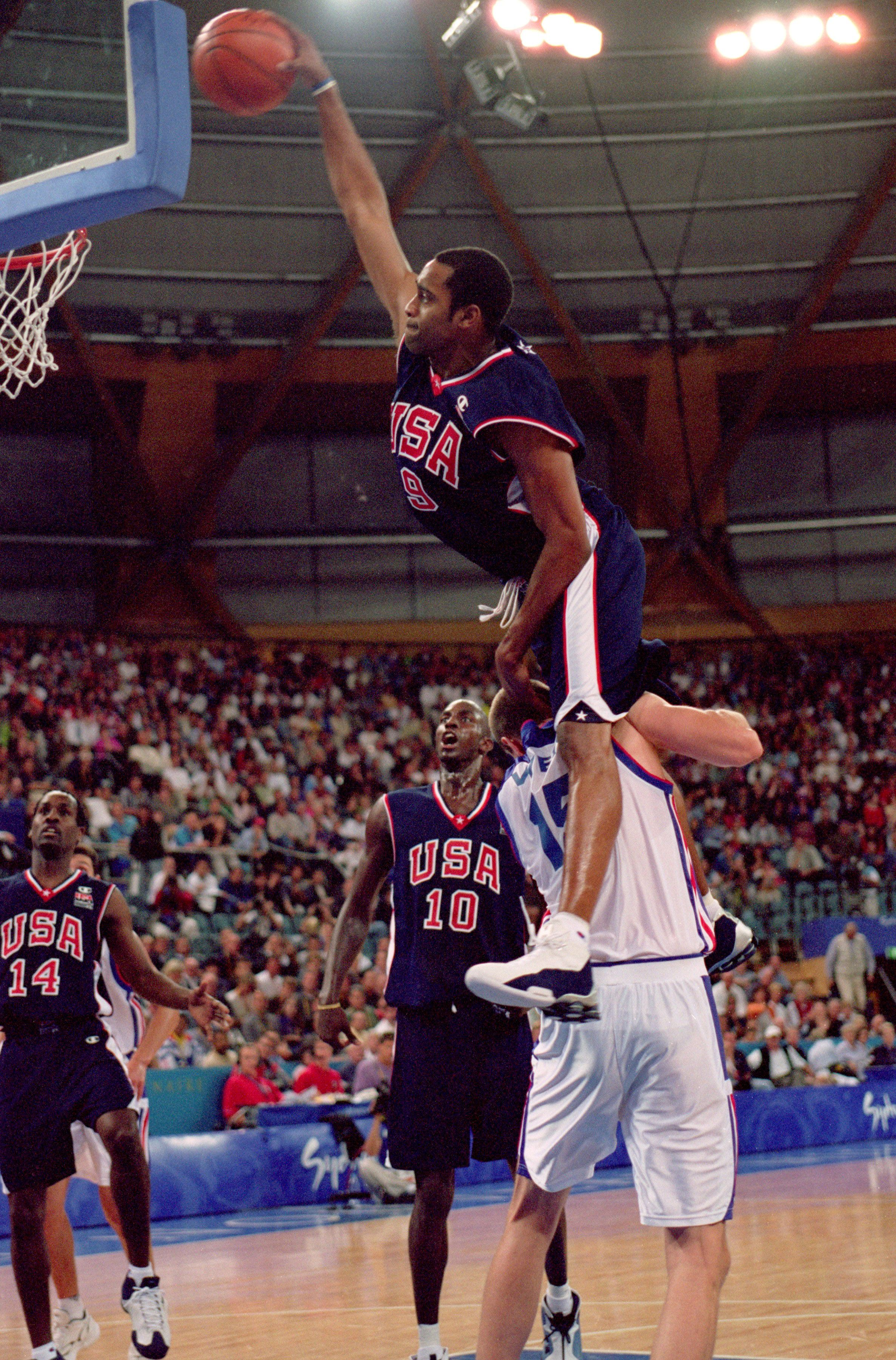 Vince Carter dunking over an opponent