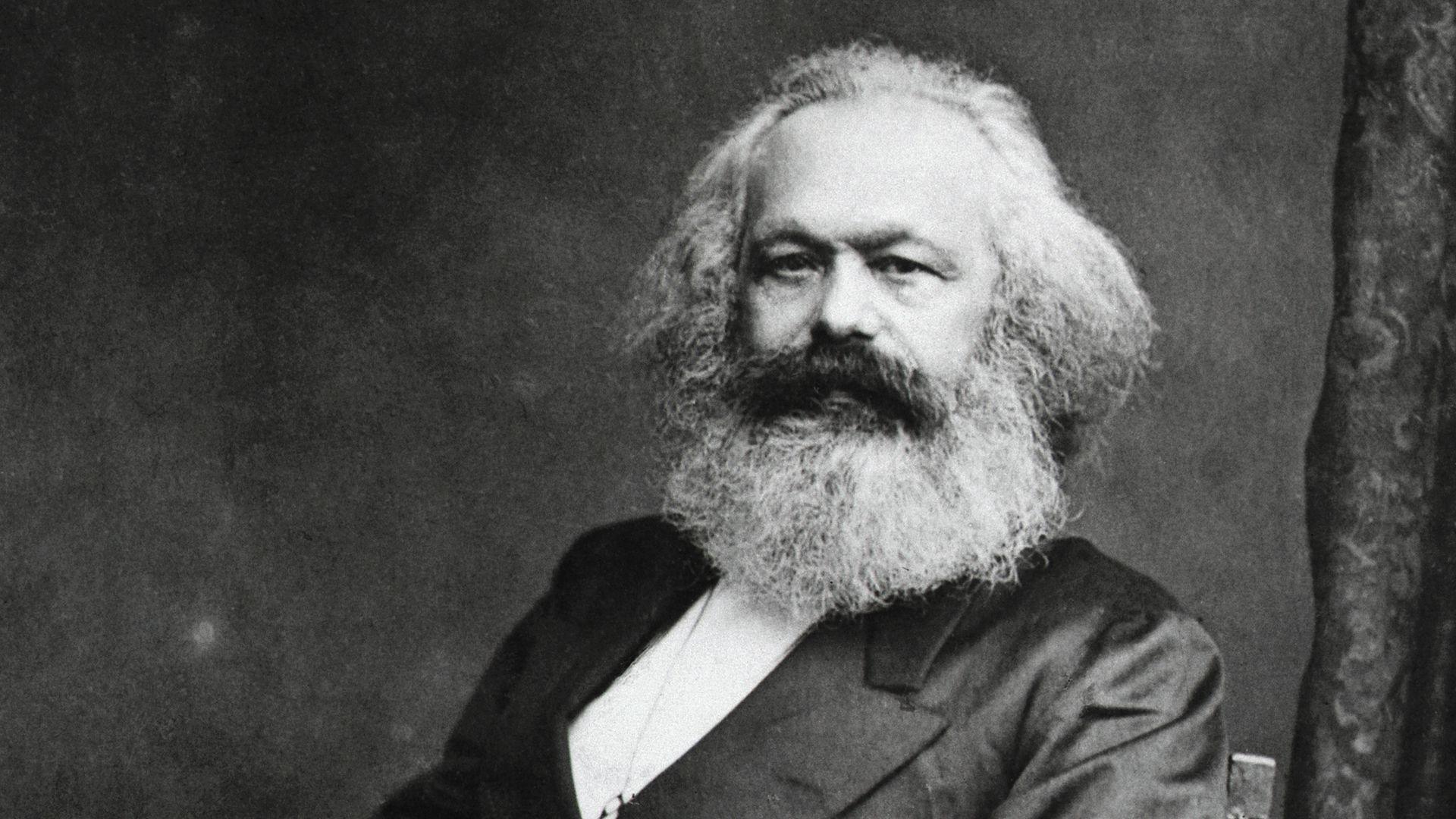 Photo of  German Political Philosopher Karl Marx sitting, 1818-1883.