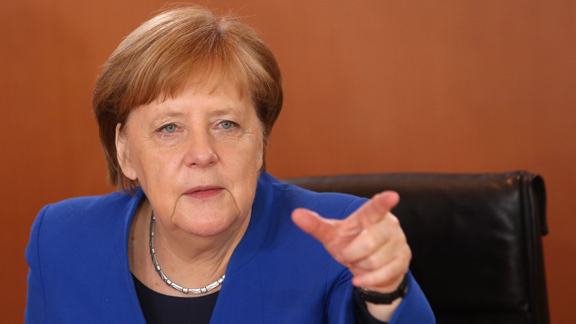 Angela Merkel speaking and gesturing