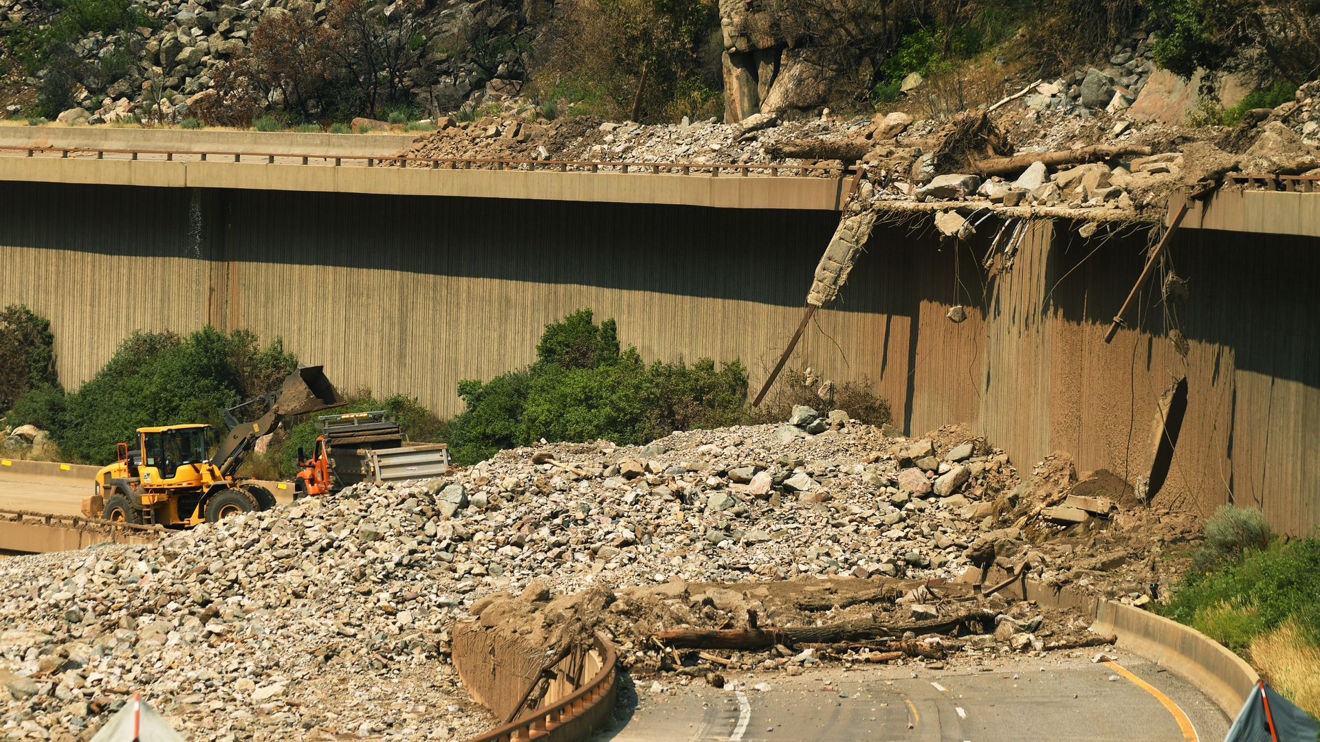 Crews work to reopen Interstate 70 through Glenwood Canyon after a mudslide in August. Photo: RJ Sangosti/The Denver Post via Getty Images