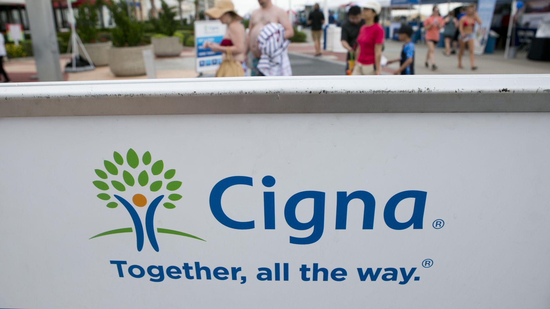 Cigna's logo on a wall.