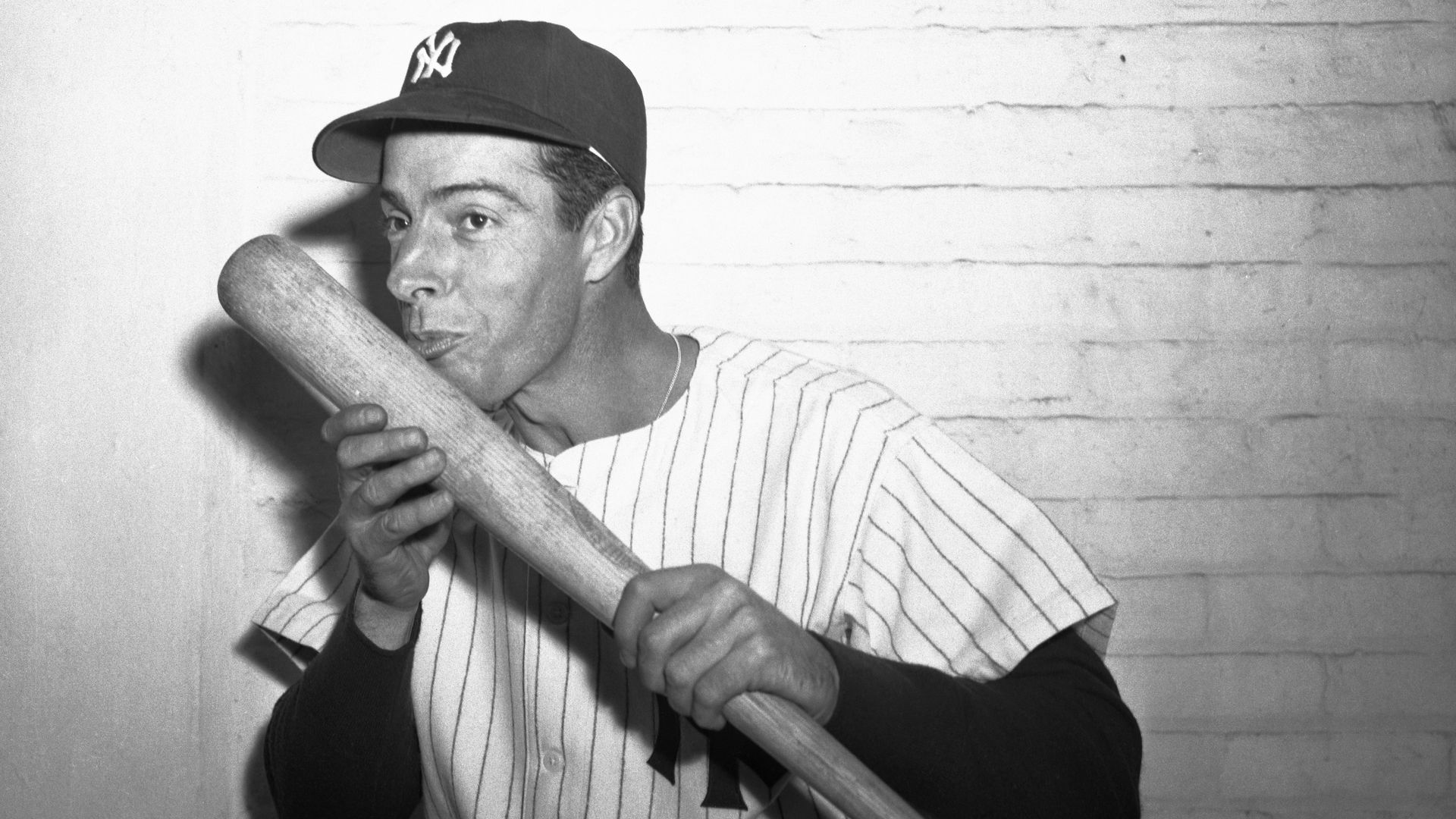 Joe DiMaggio kissing his ash bat