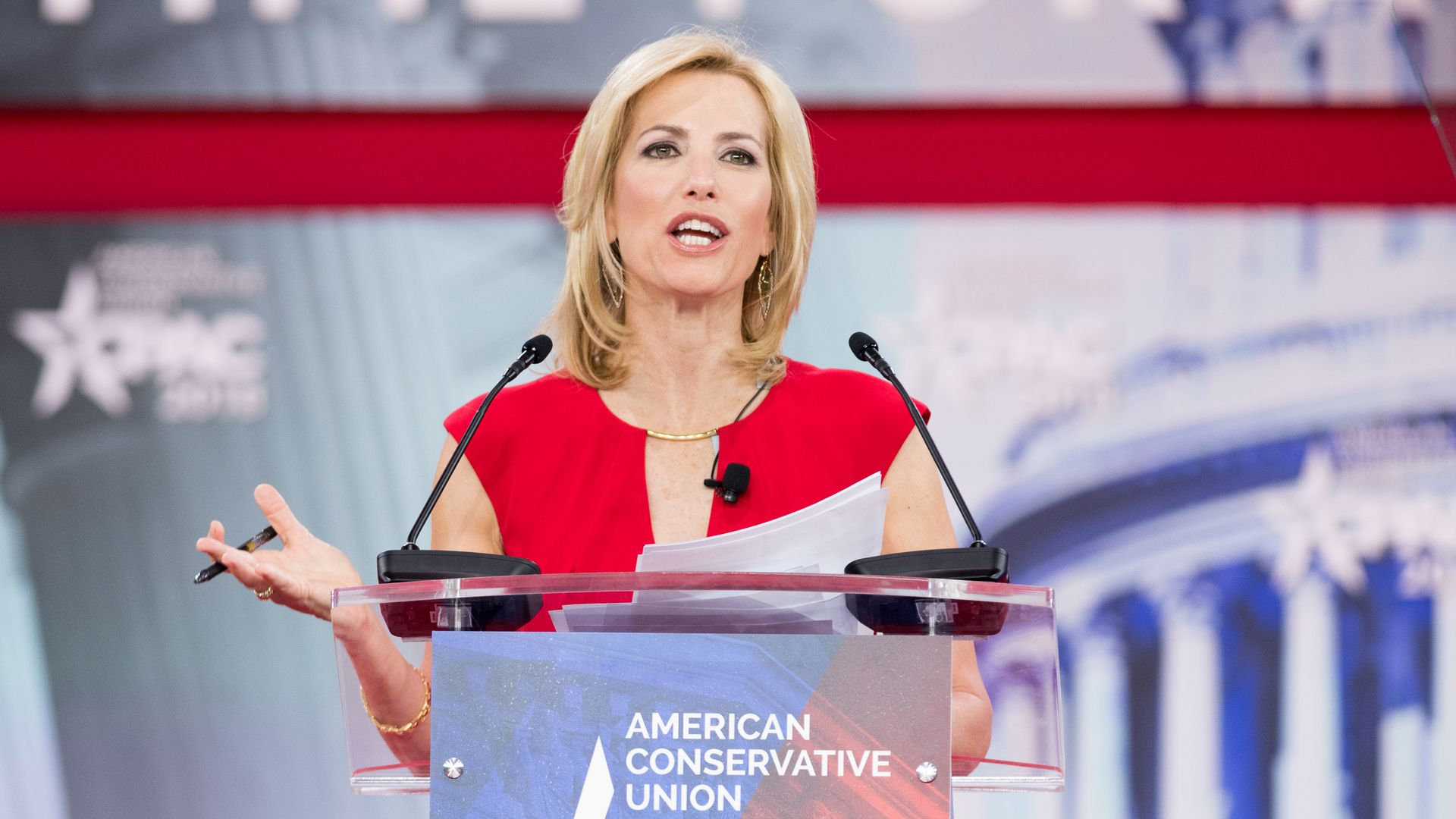 Laura Ingraham looks mad talking at a podium