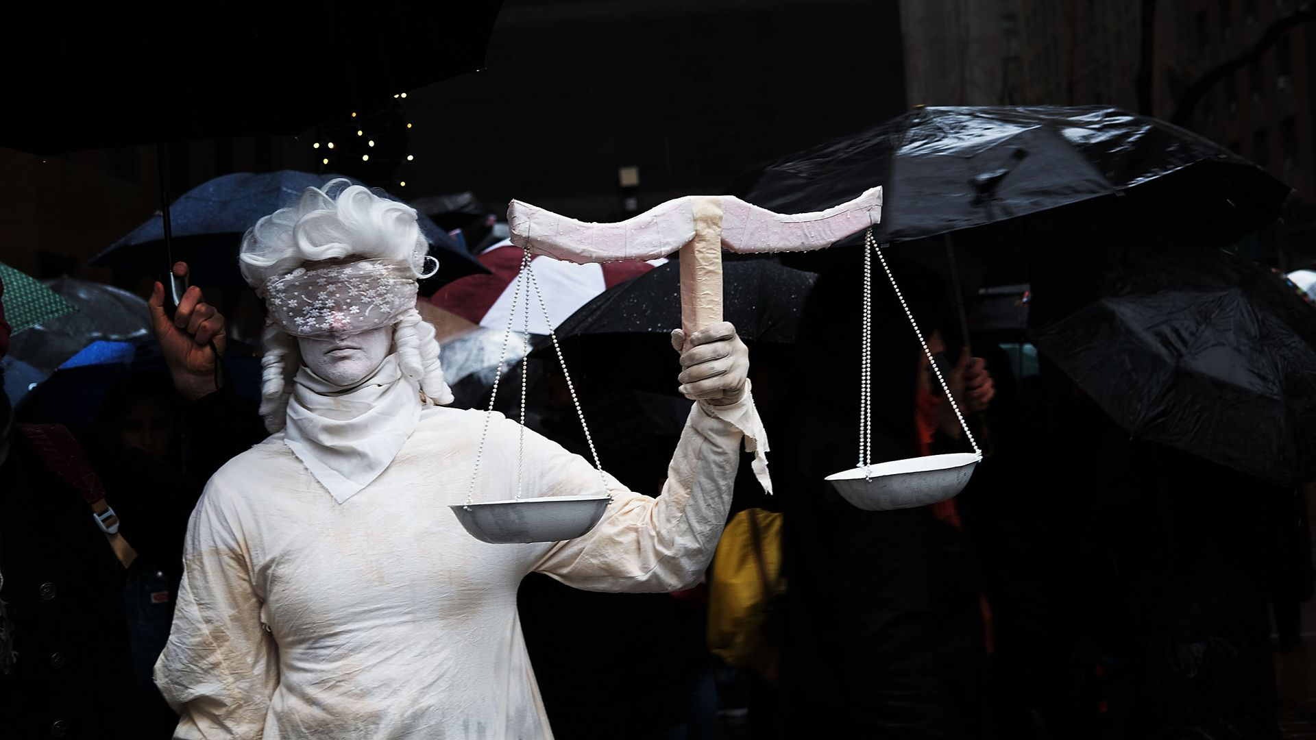 Woman dressed as lady justice blind folded