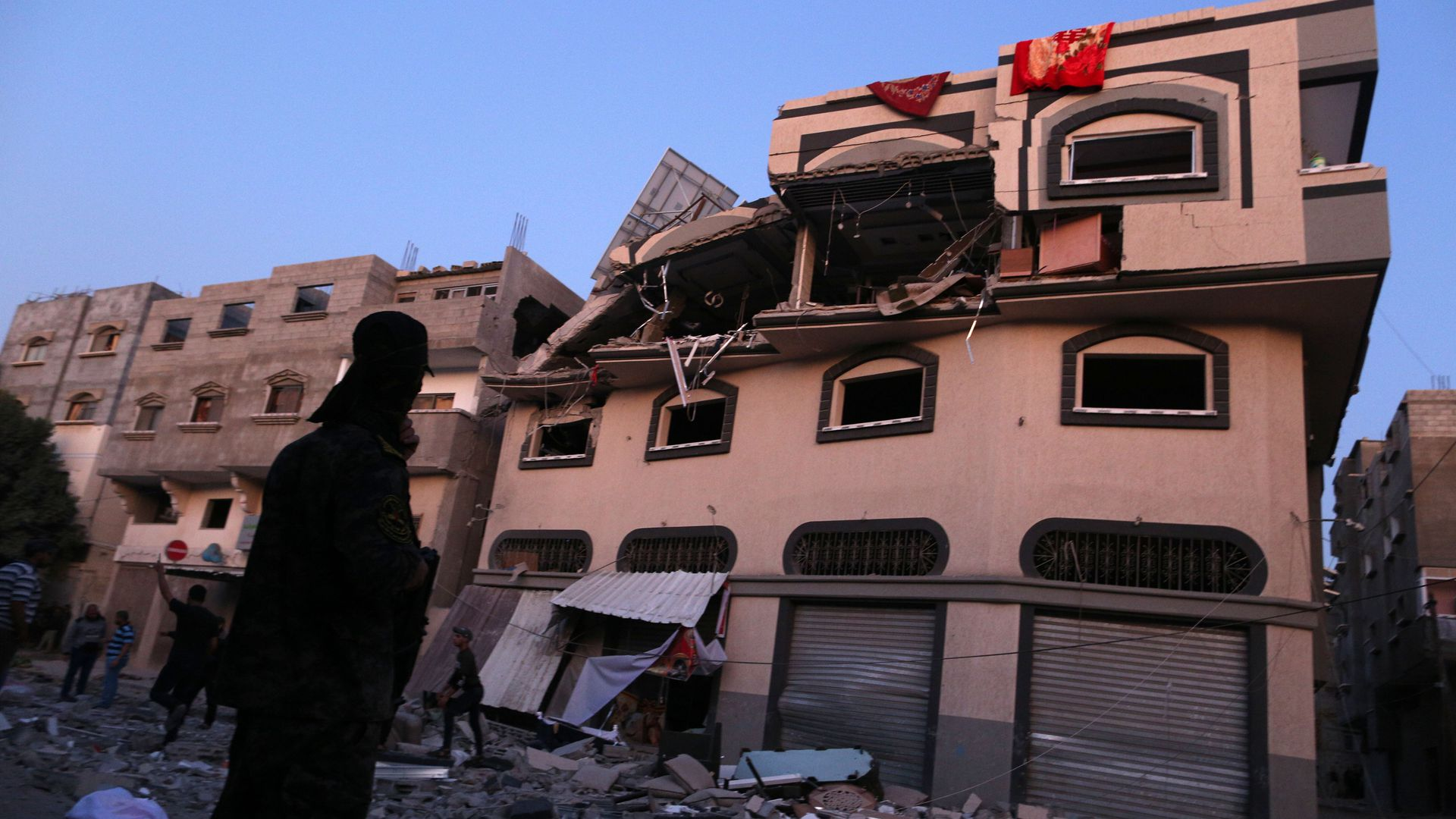 Palestinians inspect the damaged house of Islamic Jihad leader Baha Abu Al-Ata afther an Israeli attack in Gaza city, on November 12.