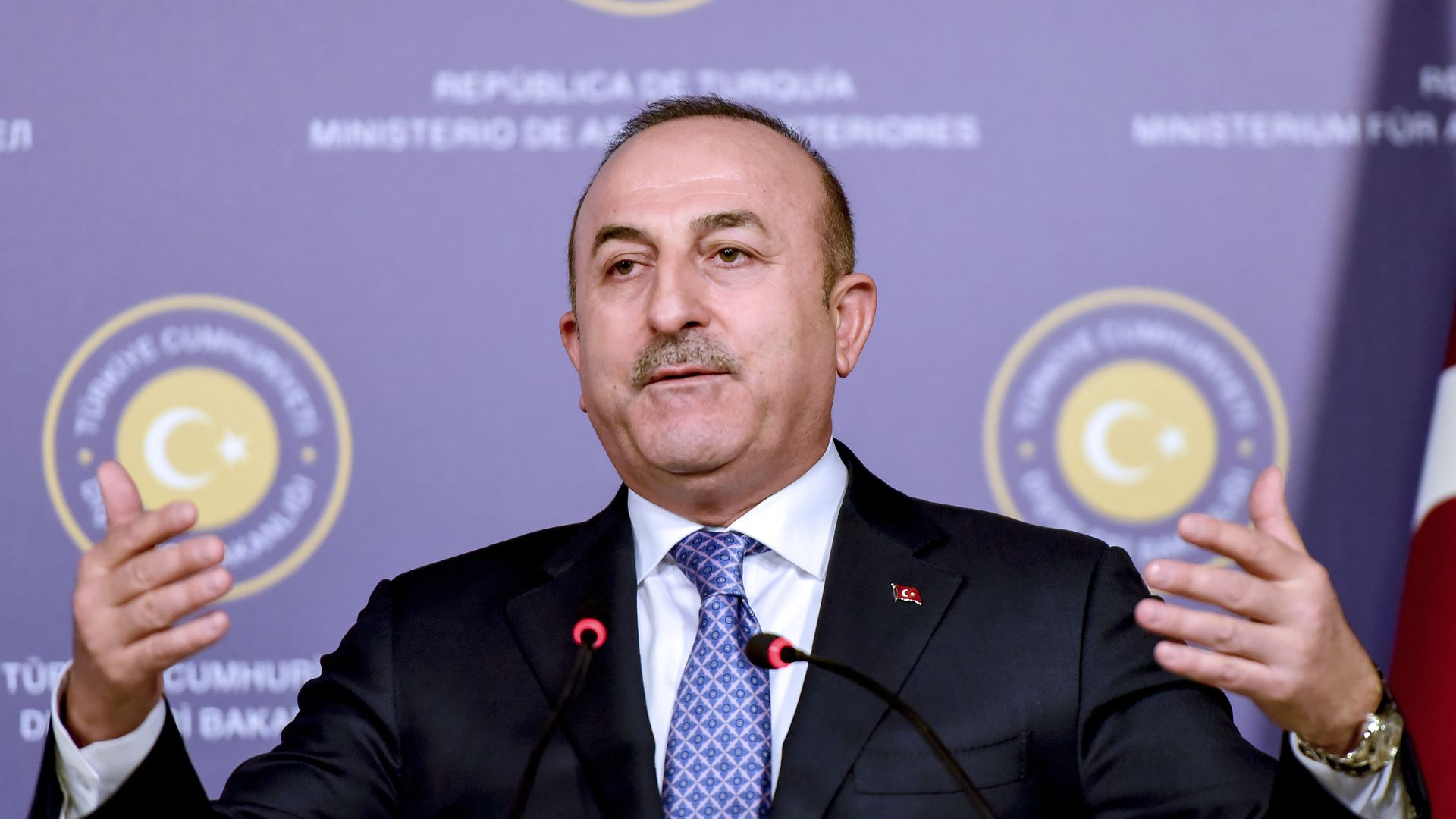 Turkish foreign minister Cavusoglu at a press conference