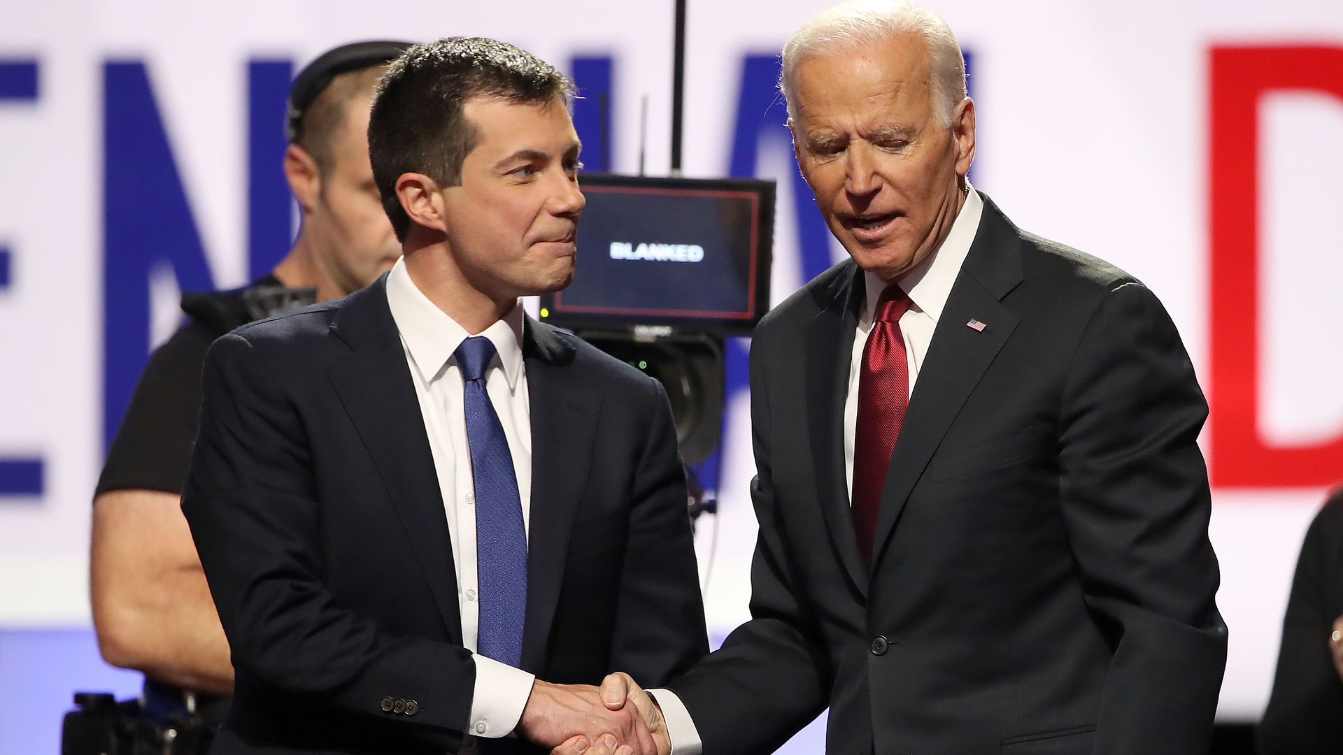 Pete buttigieg shakes hands with Joe biden.
