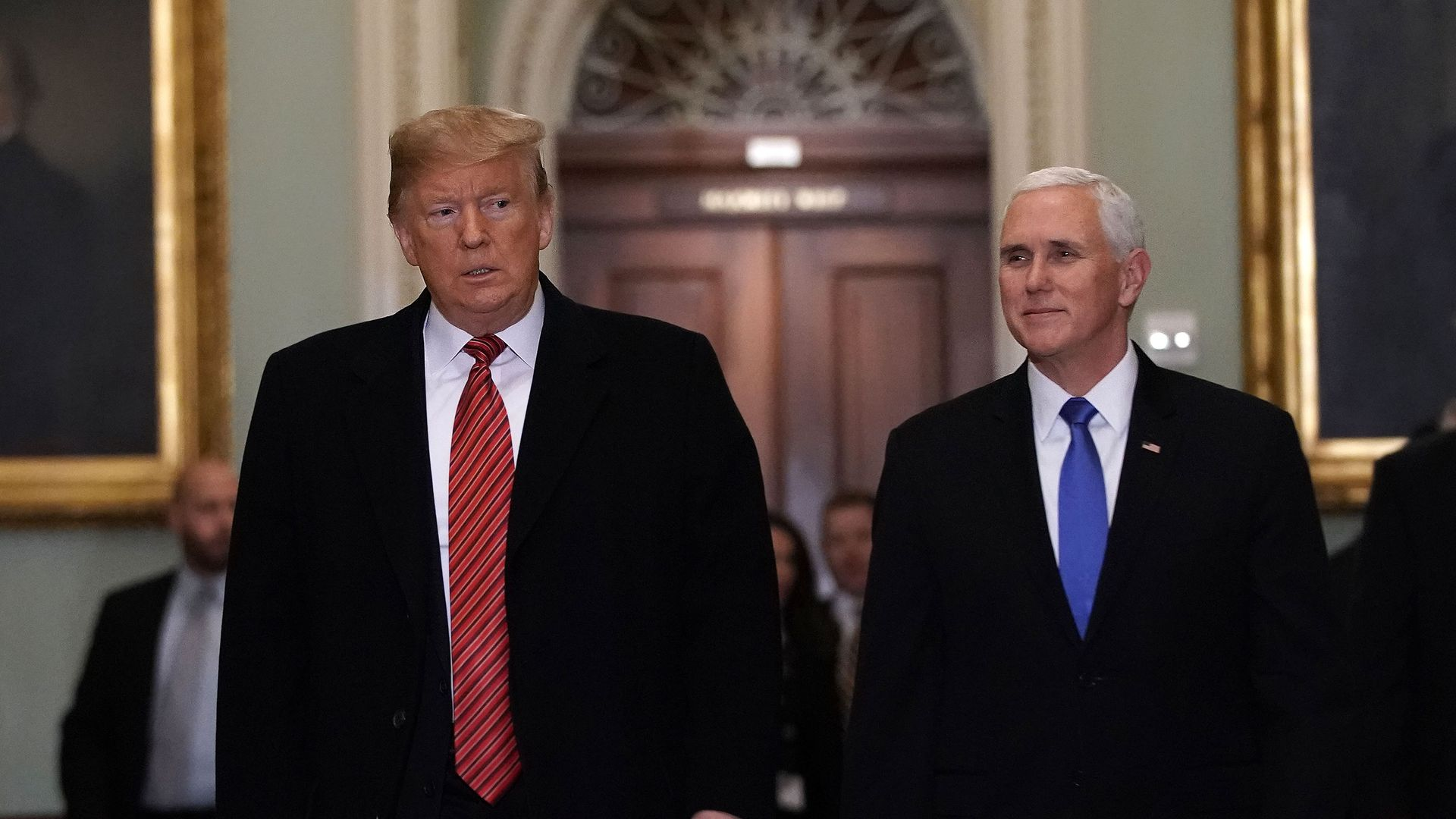 Pence and trump walking together.