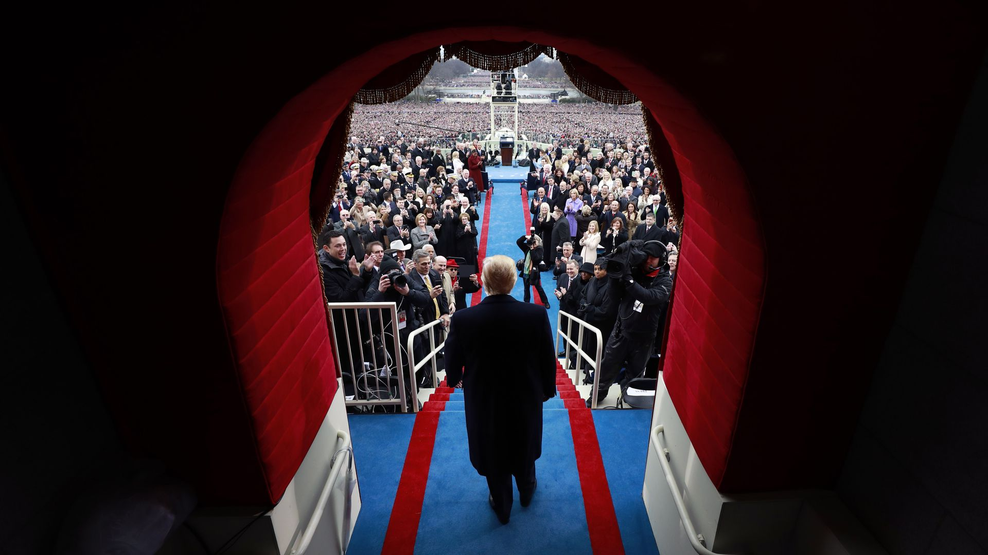 In this image, Trump walks through a tunnel at the Capitol to be sworn in as president.