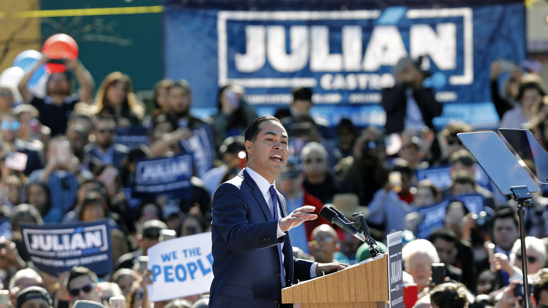 Julián Castro speaks from behind a podium at a campaign event