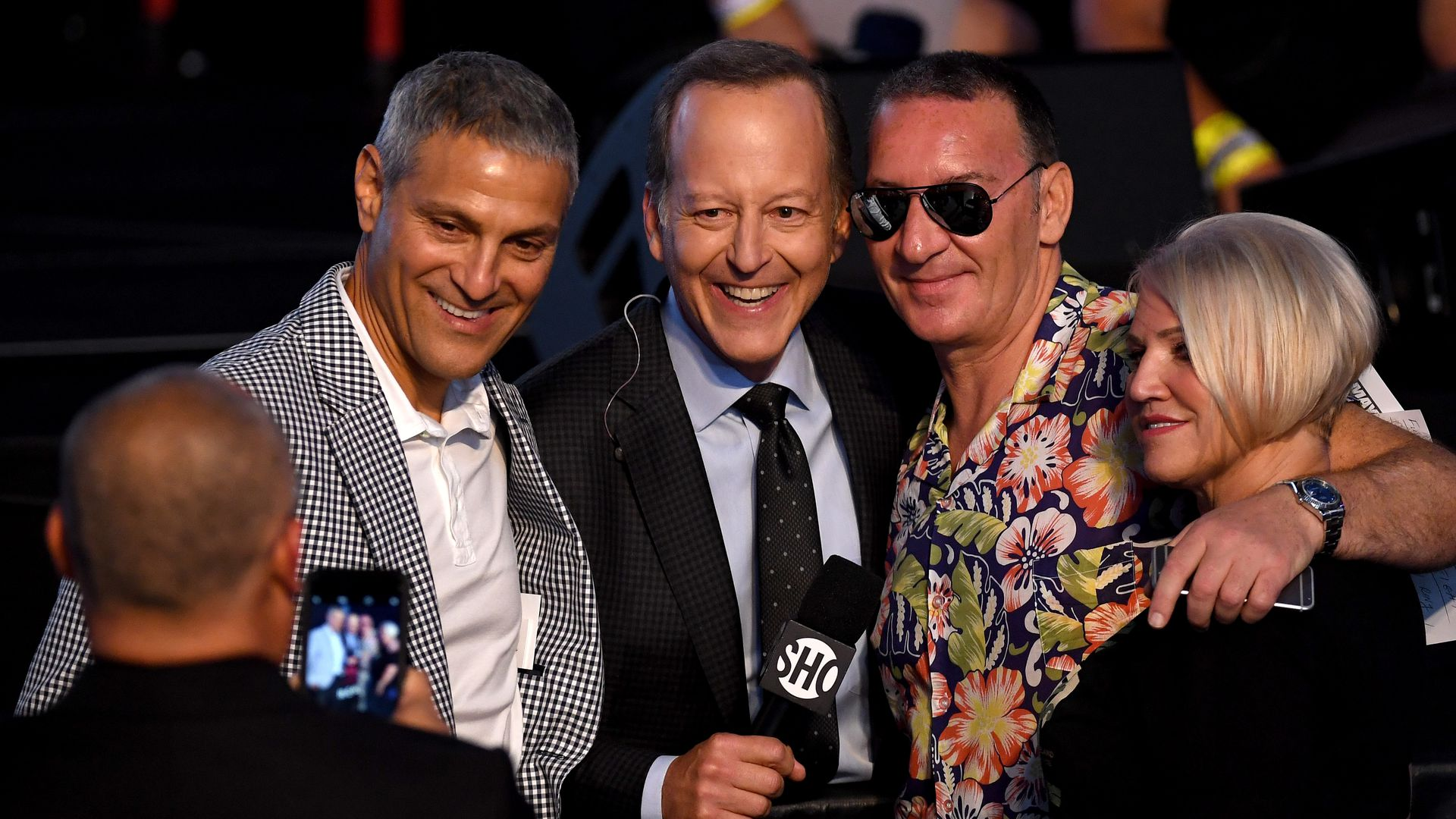 In this image, Ari Emanuel poses with two men and a blonde woman for a picture.