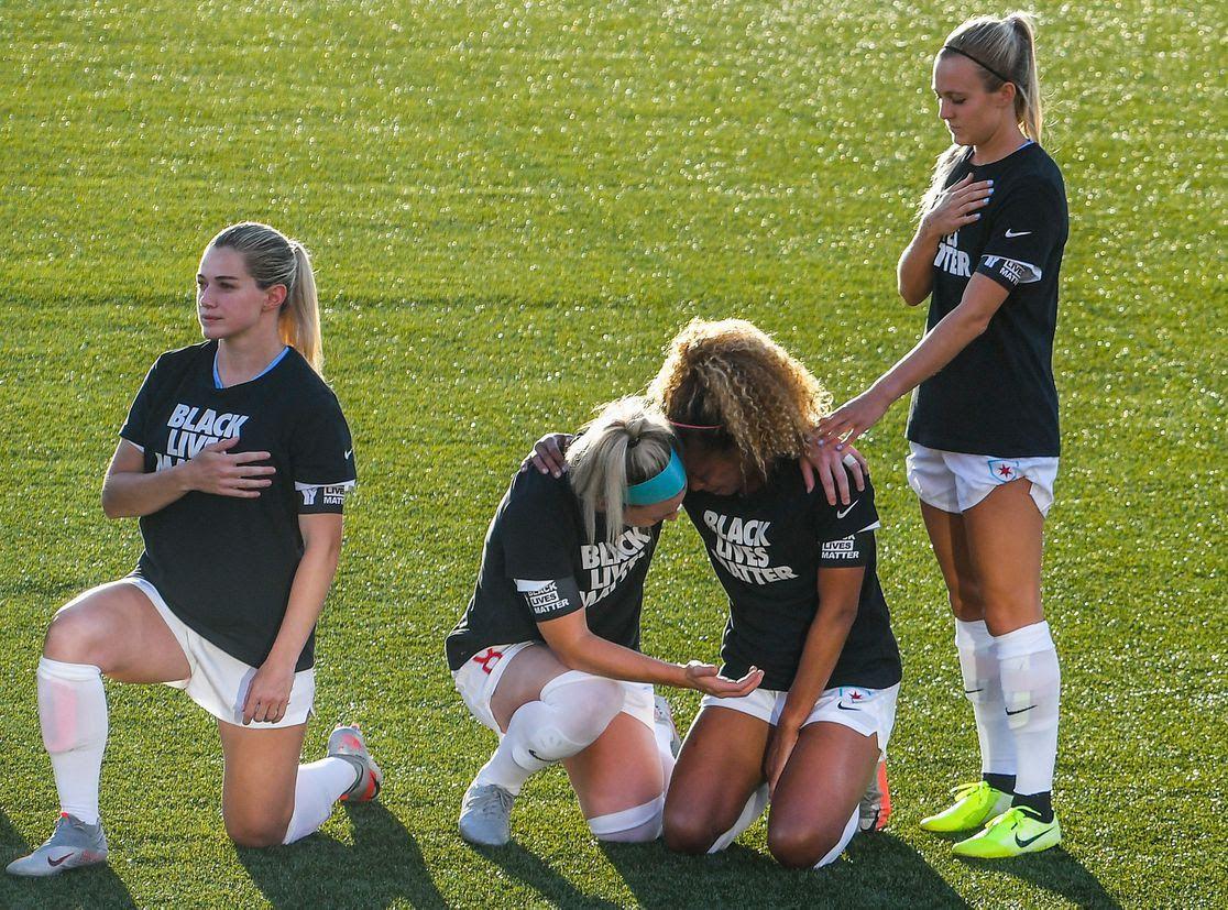 players kneeling